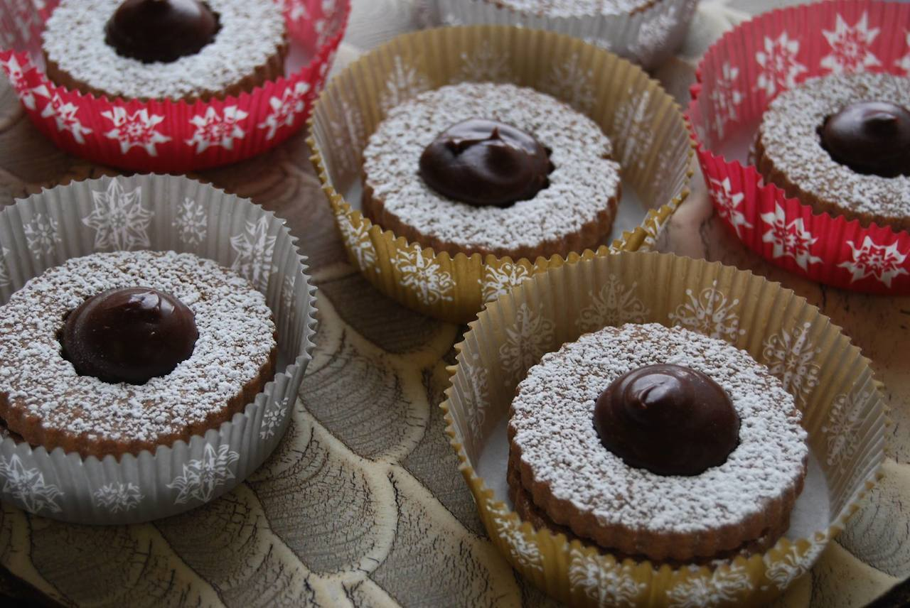chocolate sandwich cookies with raspberry preserves and chocolate ganache