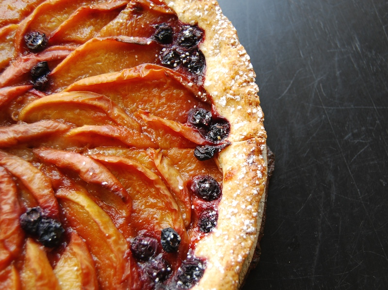 white peach and blueberry tart