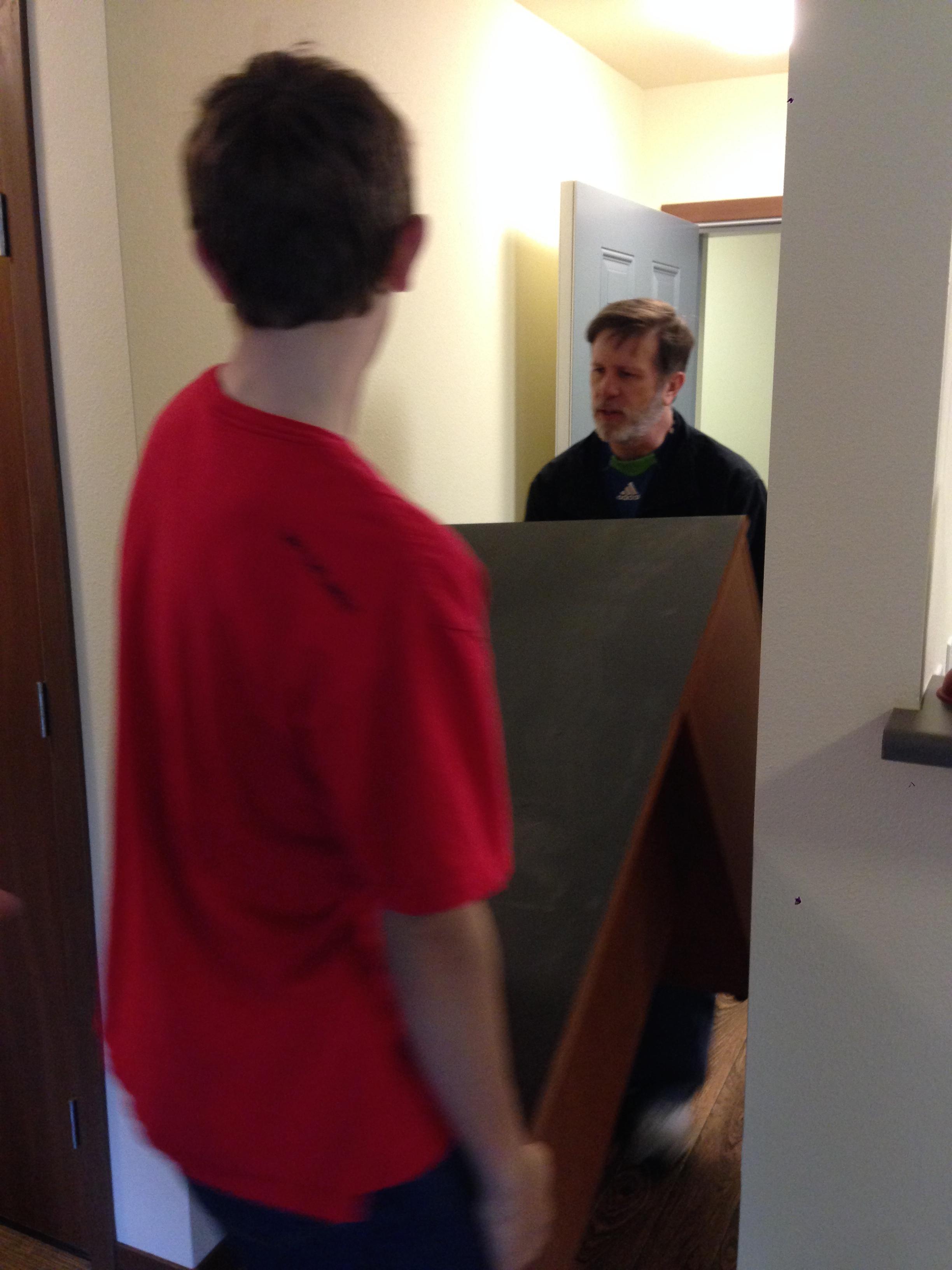 Chris and Steve helping bring in a HUGE desk.