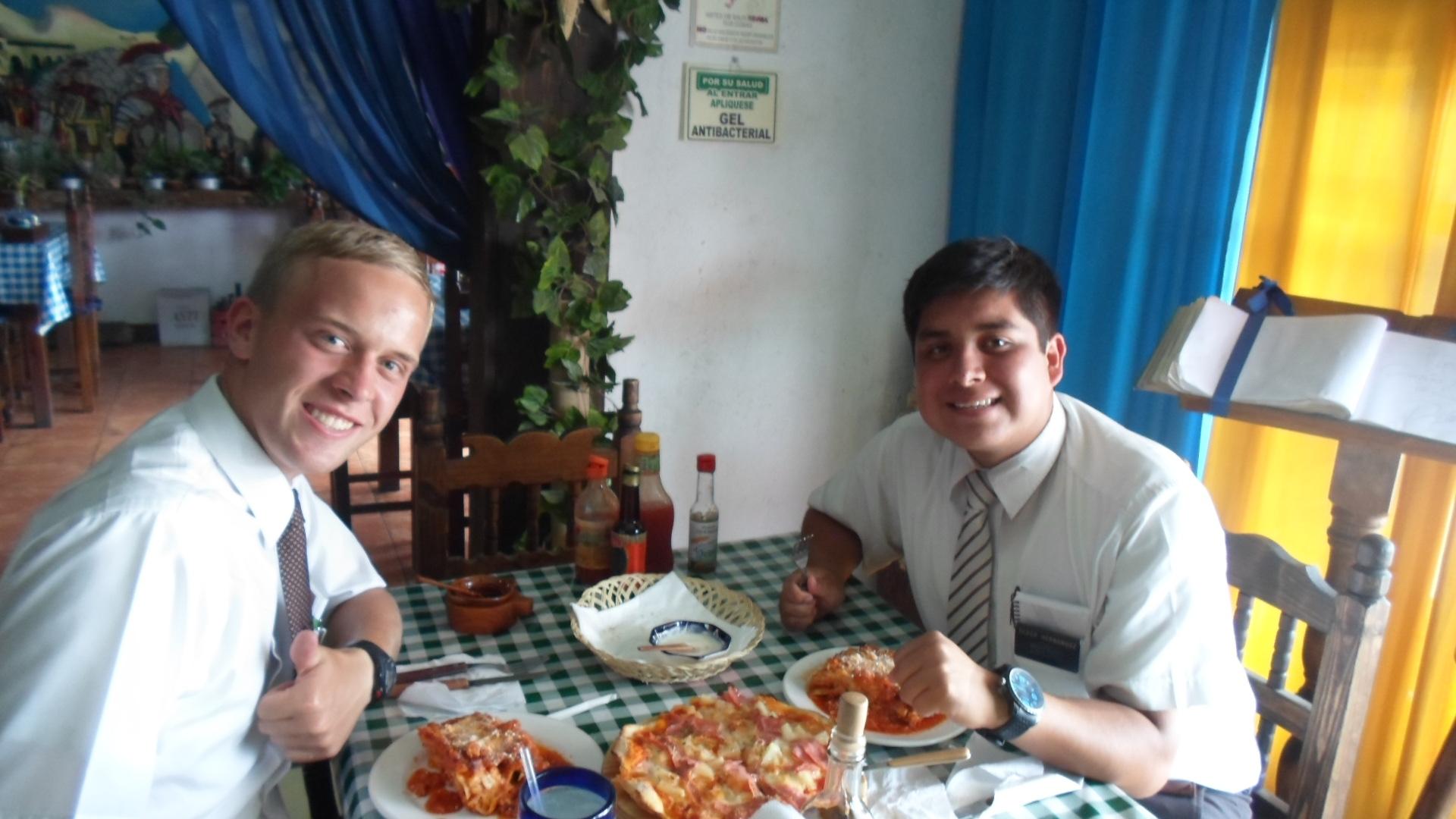 Elder Jason Blanding and Elder Hernandez enjoying Lasagna!