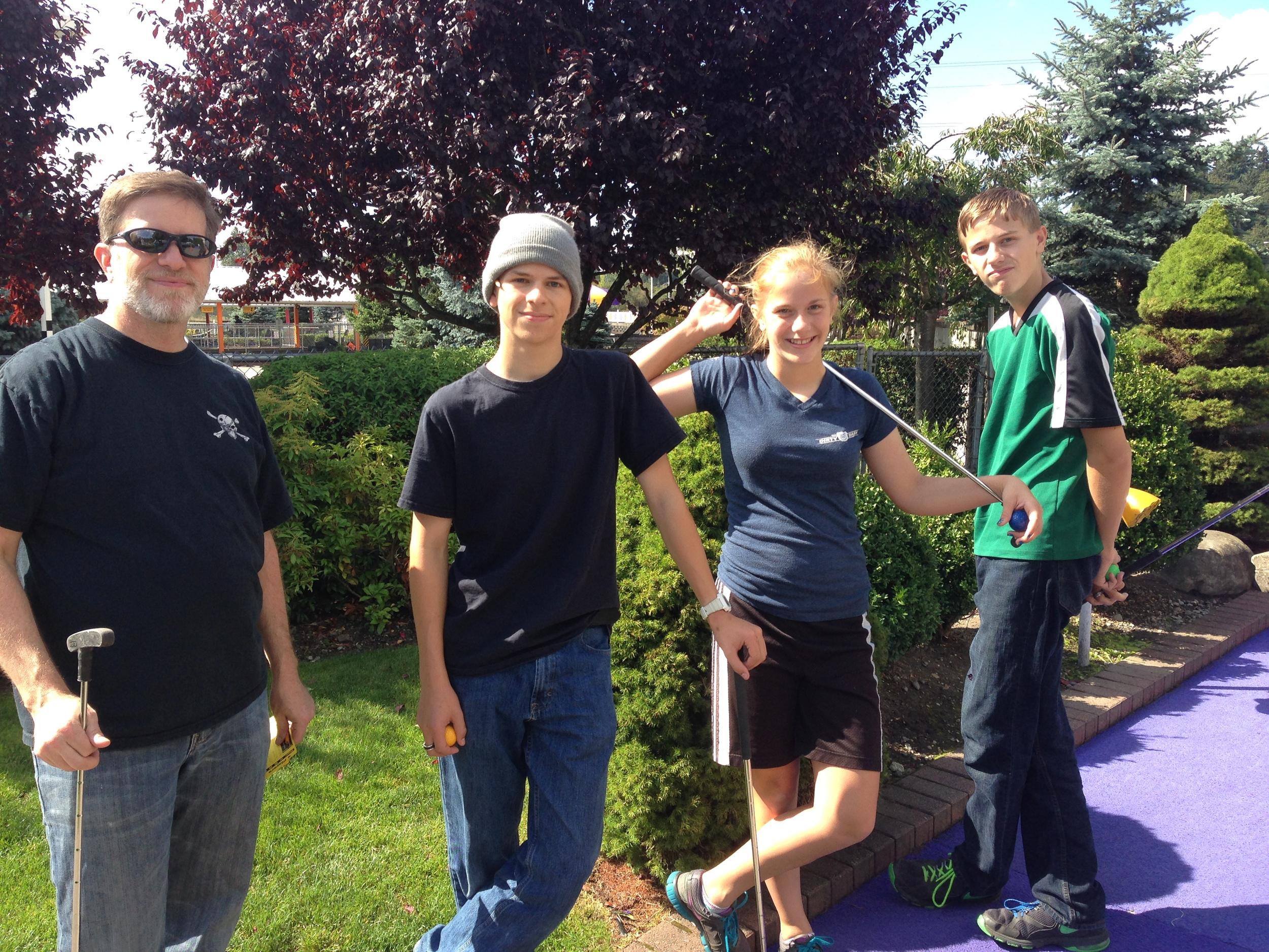 Steve, Matt, Jessie and Chris playing golf.