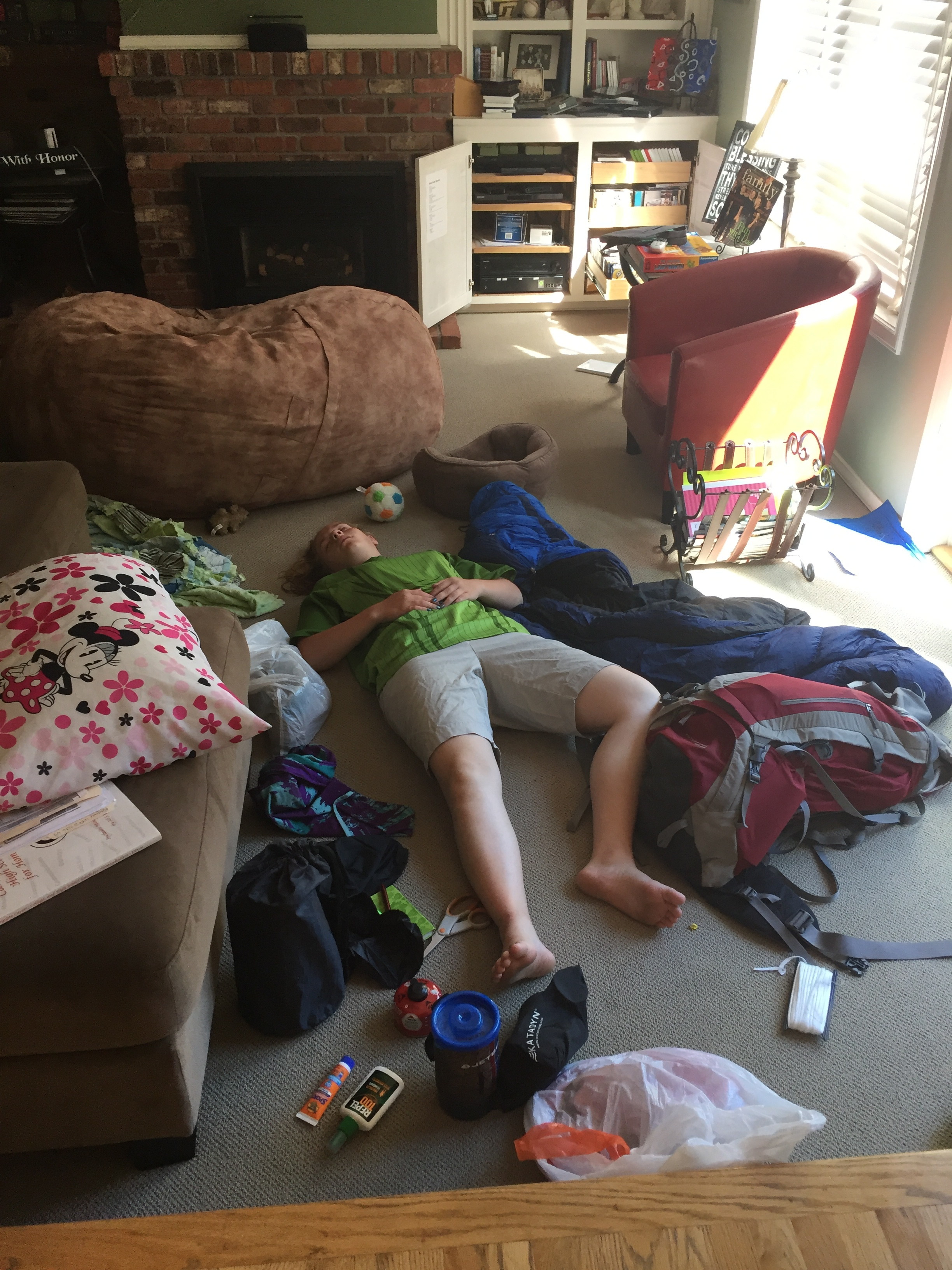 Jessie upon arrival home from girls camp. She didn't even get her bags unpacked before she was out!