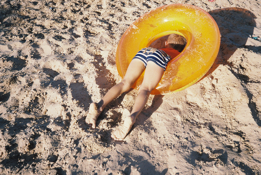 ^ That time Jasper ran down the hill, completely biffed it, and was stuck in his inner tube face down in the sand.