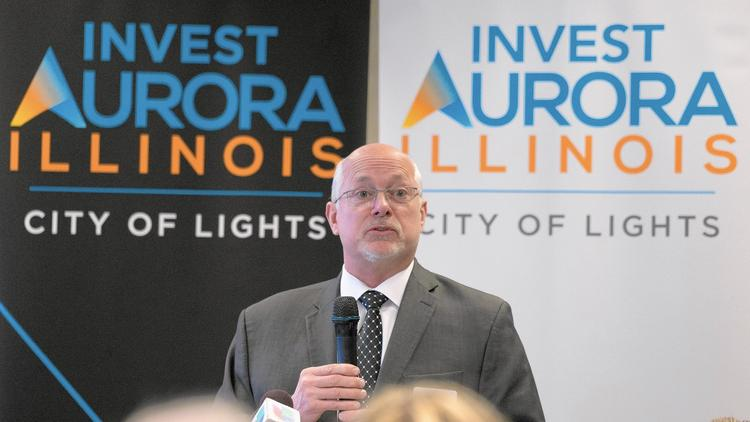 David A. Hulseberg from Invest Aurora speaks during a press conference at the old Aurora Public Library building in downtown Aurora Monday. A high tech company will move into the building. (Sean King / The Beacon-News)