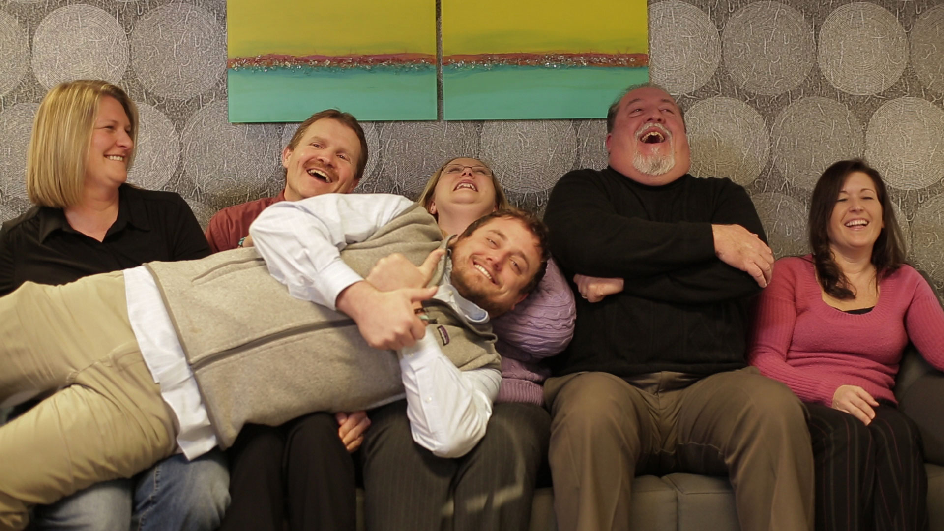 Members of the Ledgeview Partners team get comfortable in front of the camera.
