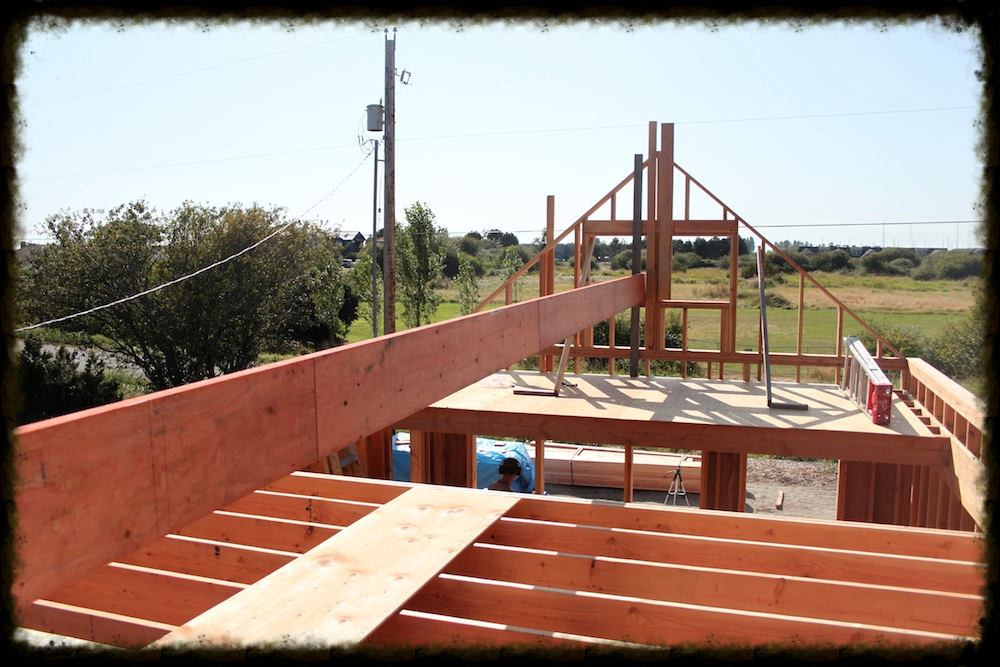 The ridge beam, a 32' LVL, moved up to the first level of staging. We moved the beam into place step by step so that we could accomplish the task between the two of us.