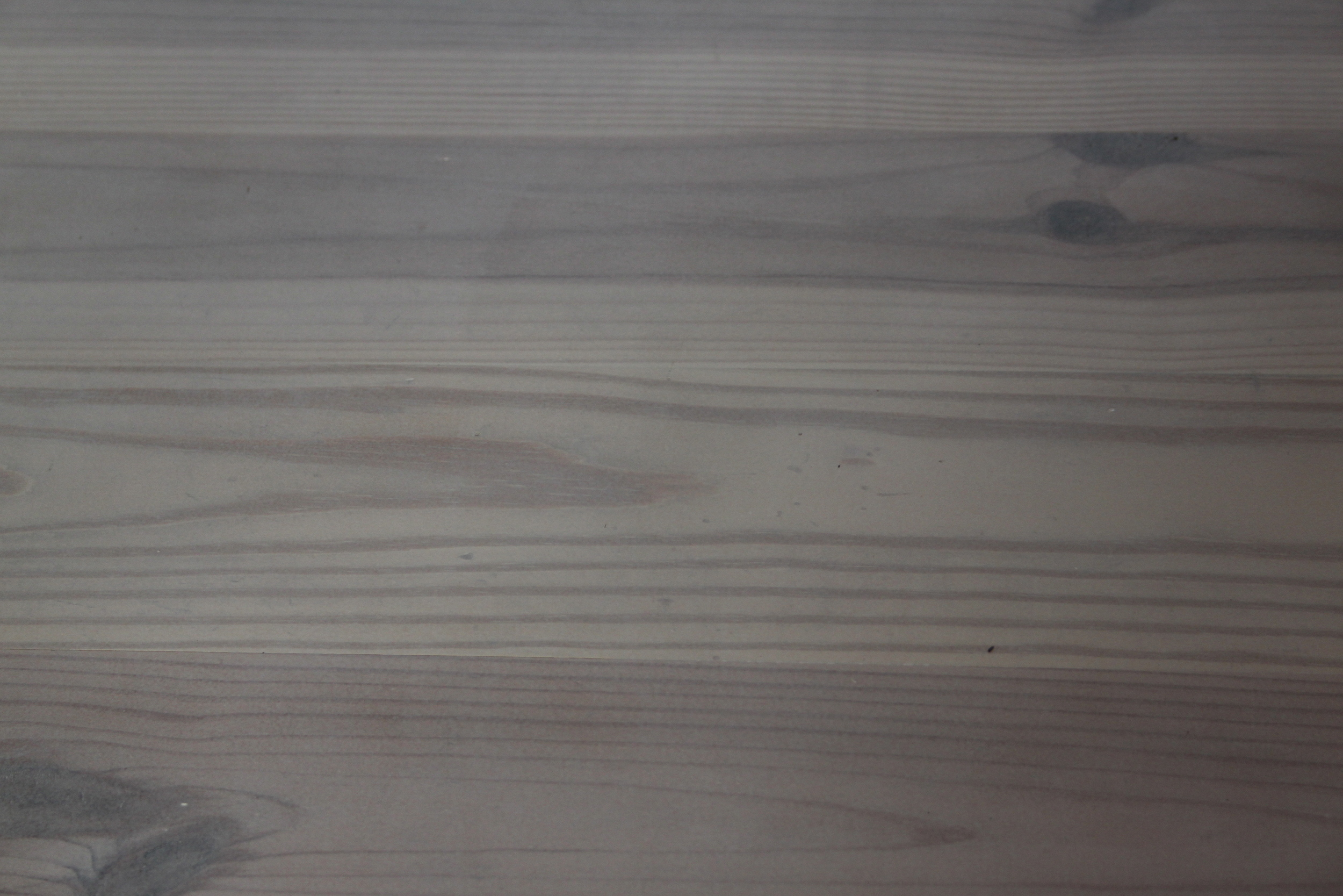 Close-up of the finished white washed floor.