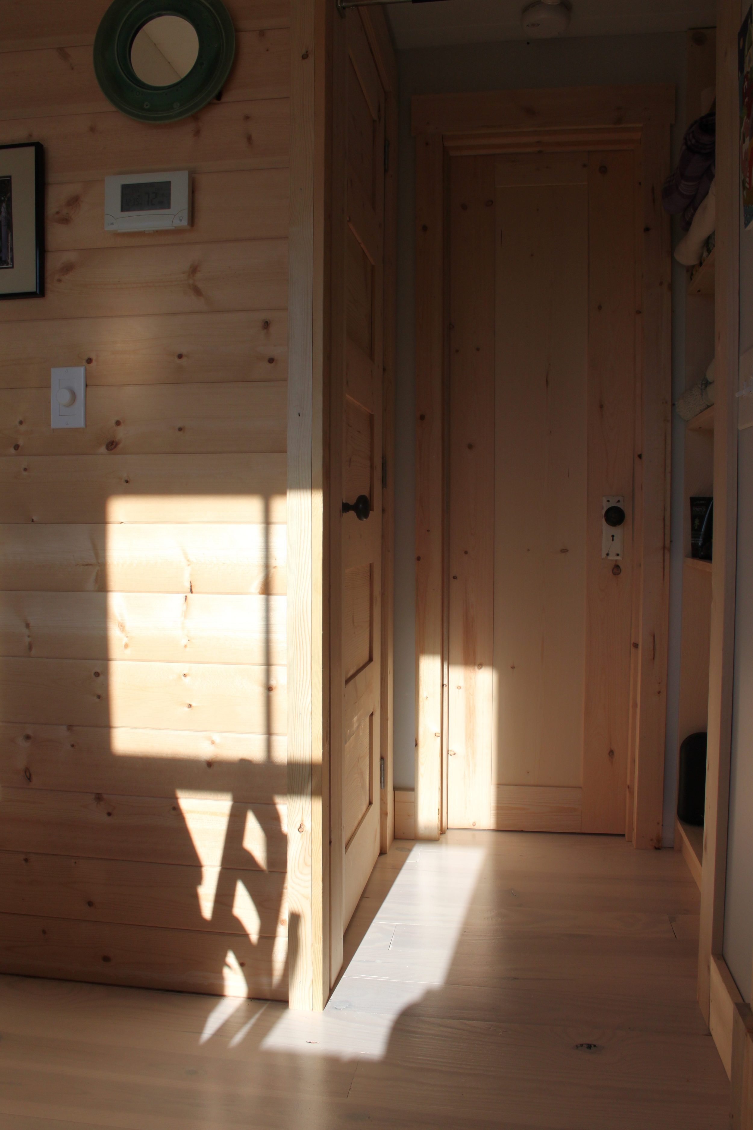 Hand made doors w/salvaged hardware: laundry room (left); bathroom (right) - unpainted.