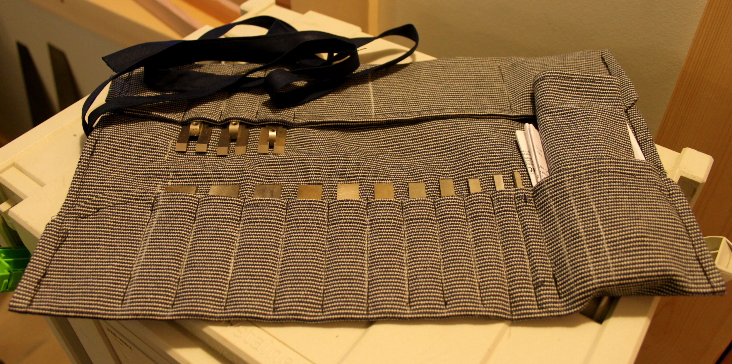 Open tool roll displaying all the cutters - both tongue & groove.