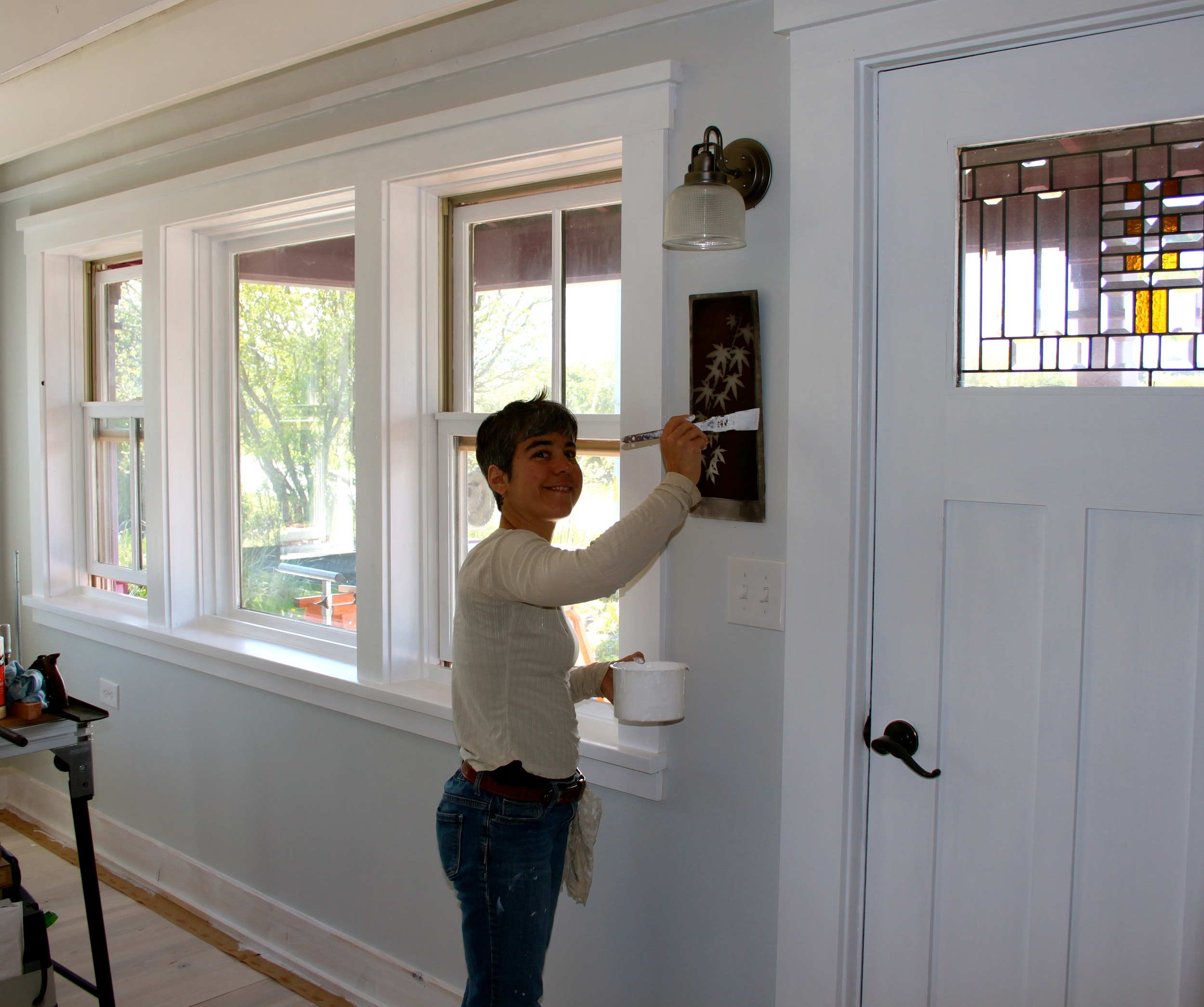Brush painting site-built casings and trim adds a vernacular charm.