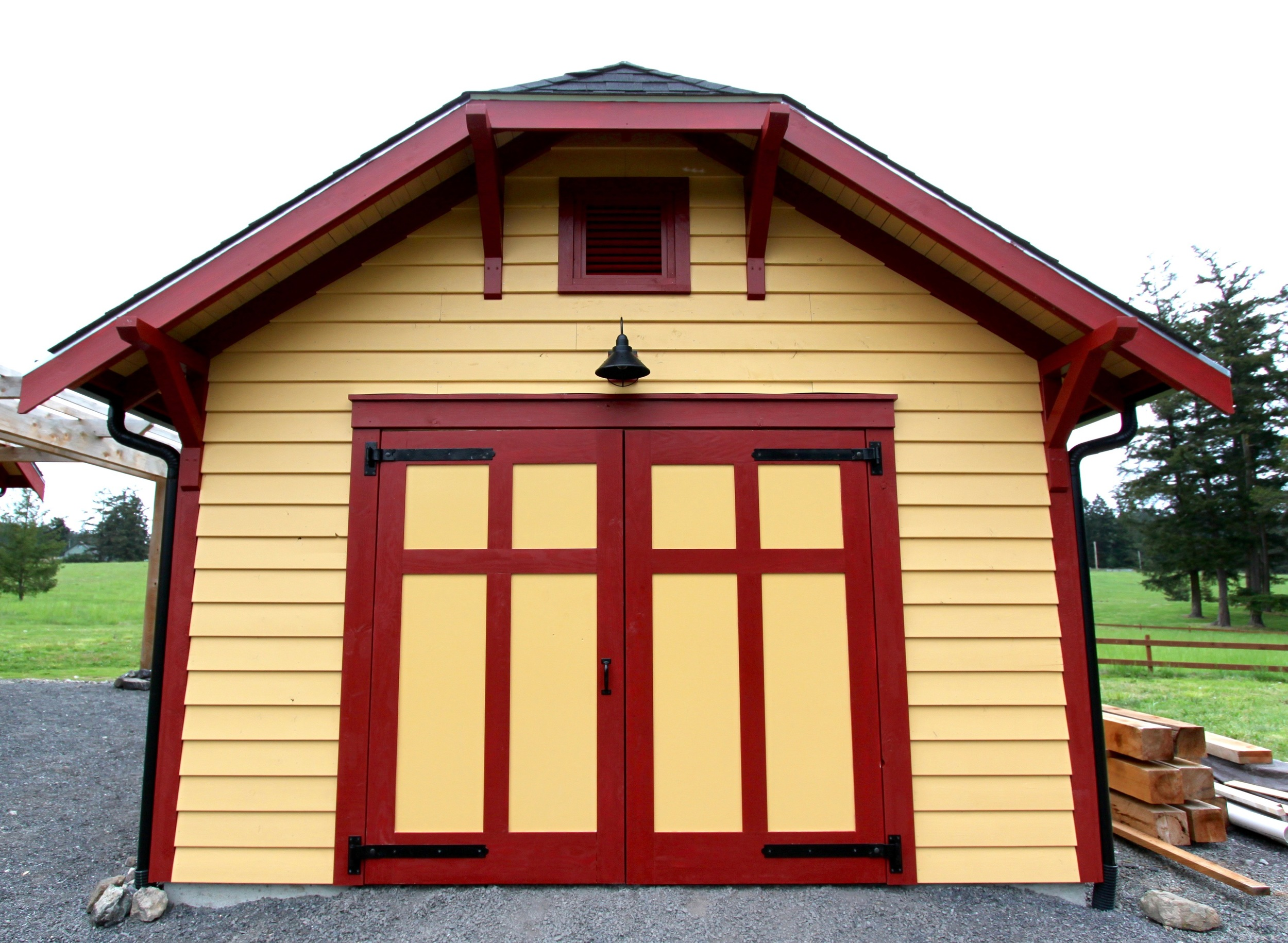 Hand built carriage house doors with steel strap hinges.