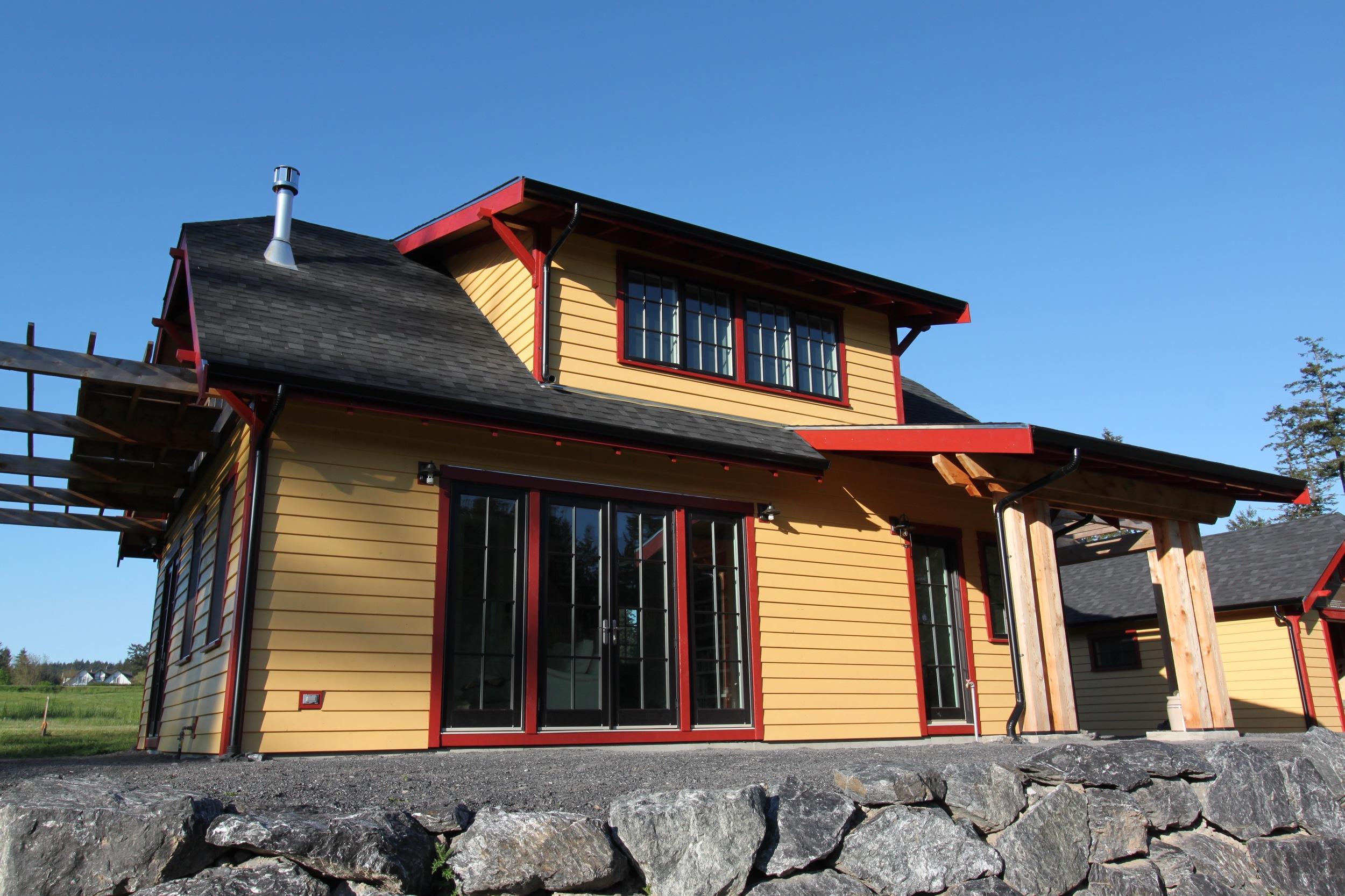 small house with bright cedar siding.jpg
