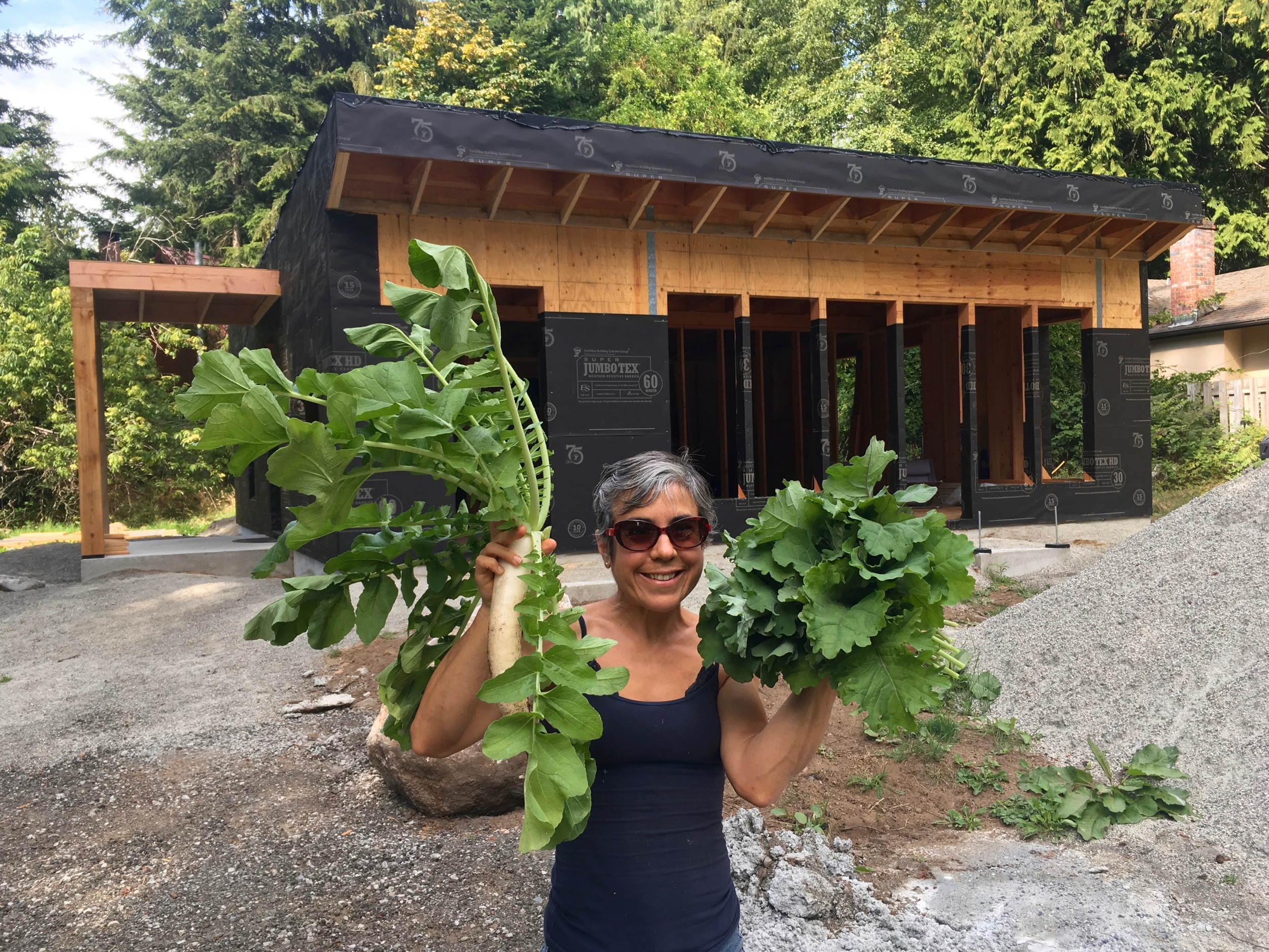 Me with my GIANT daikon radish and a bunch of kale - it already feels like home!