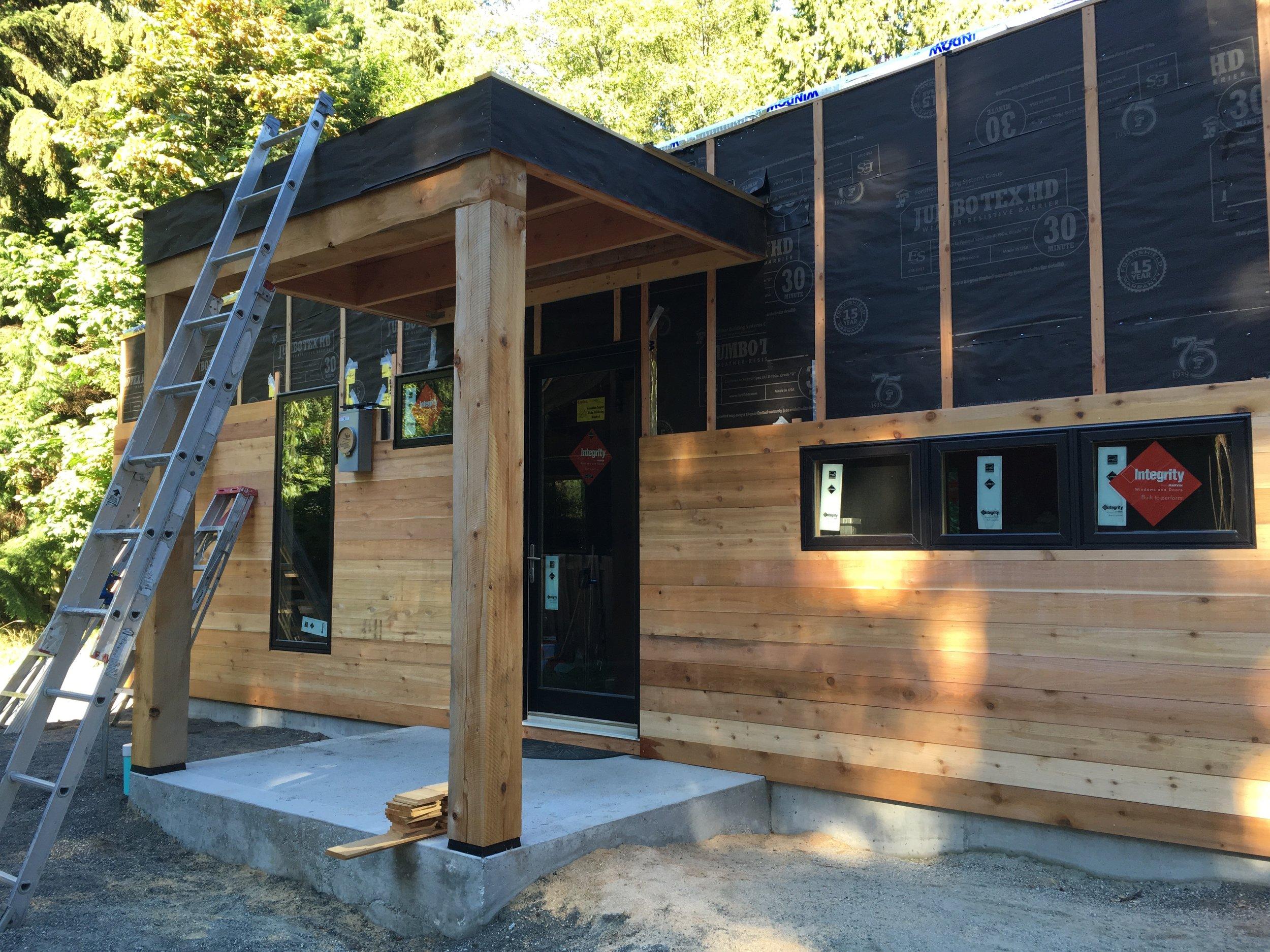 1x5 cedar shiplap siding with rainscreen.