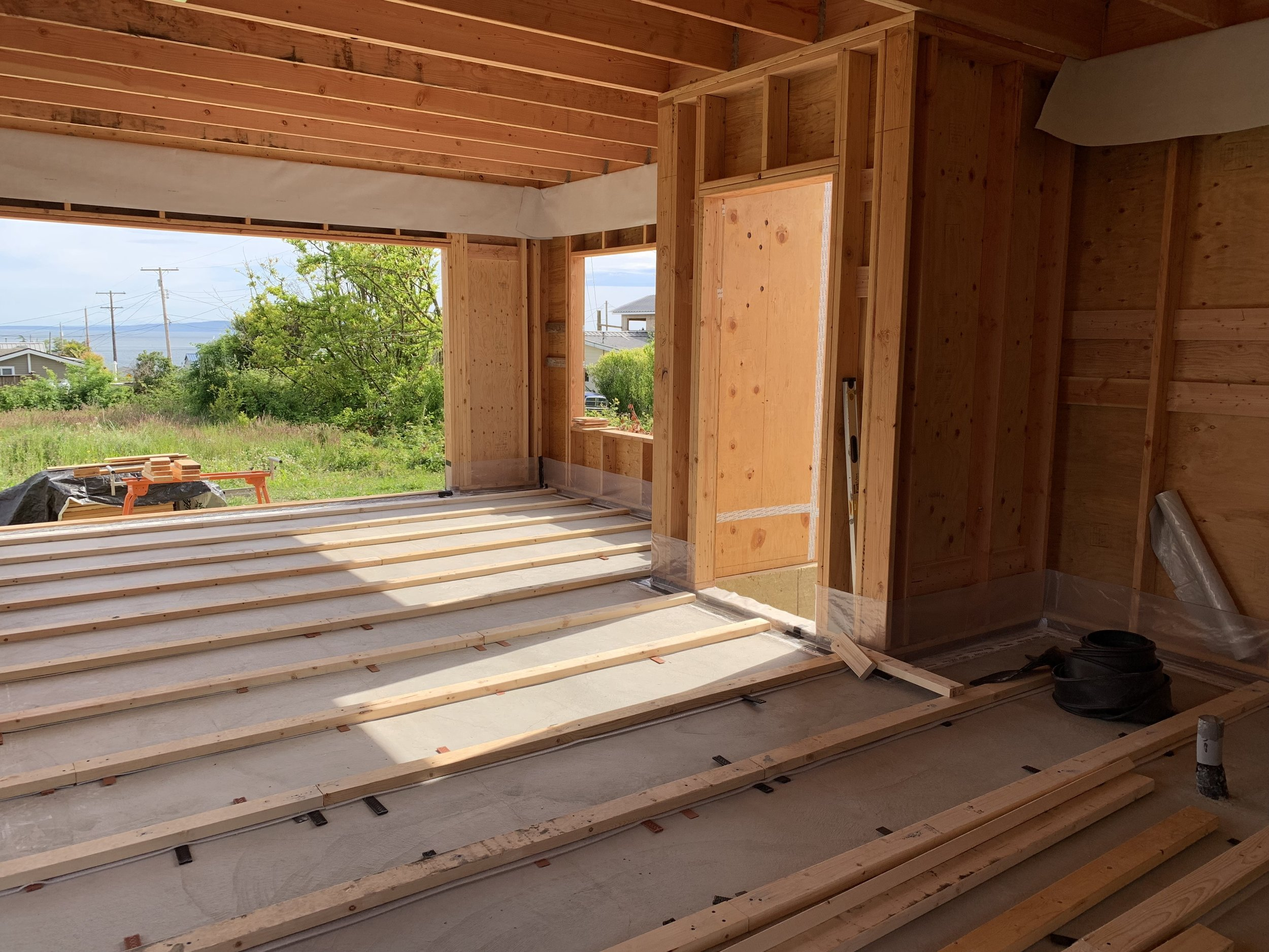 Sleeper sub-floor for a wood-over-concrete floor