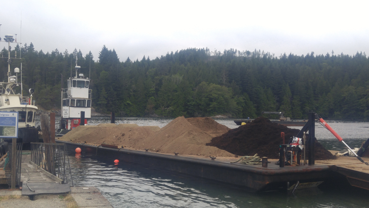 Product being barged to Oyster Island