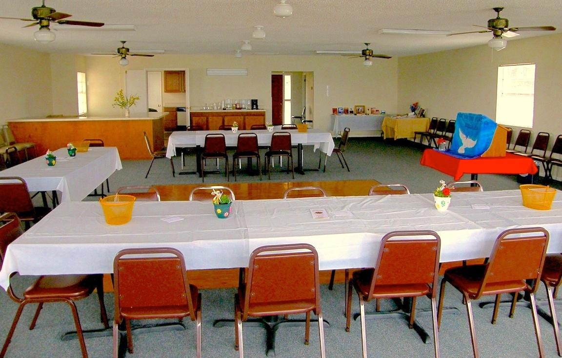 Clubhouse upstairs Meeting / Party room, set up for a meeting. Serving Bar and Kitchen in rear left of photo.