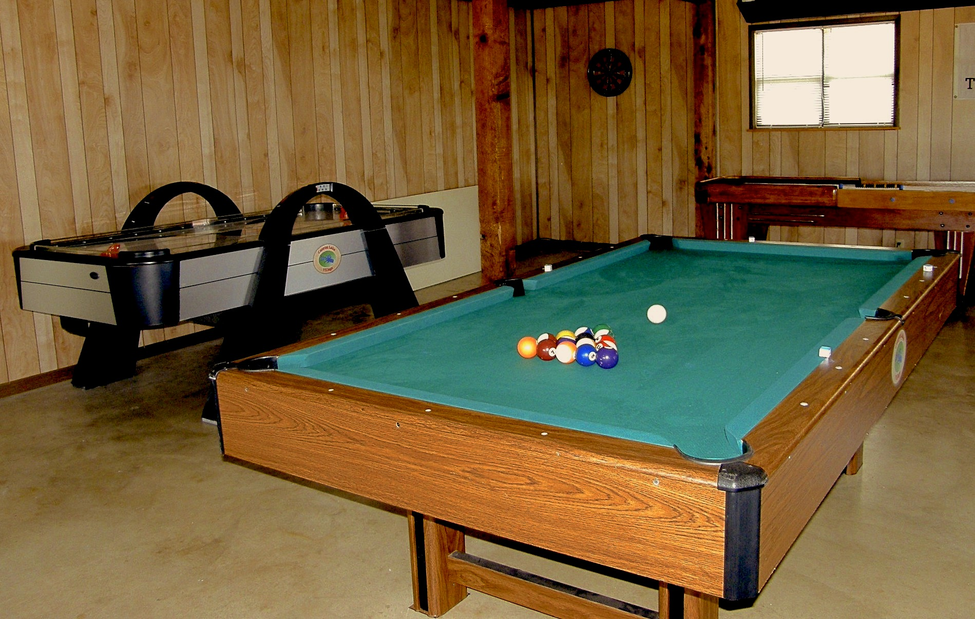 Game Room includes Air Hockey, Pool Table, Ping Pong, and a wonderful restored antique 22 foot Shuffleboard table.