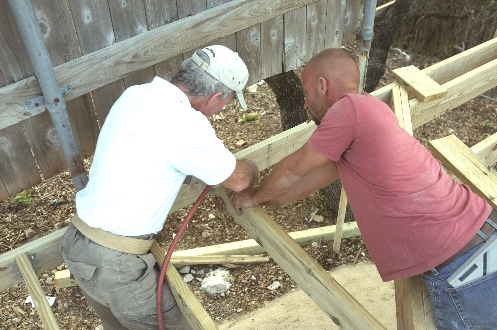 Board Members Ron H and Mike S, building a new pool deck and fence on 2013.