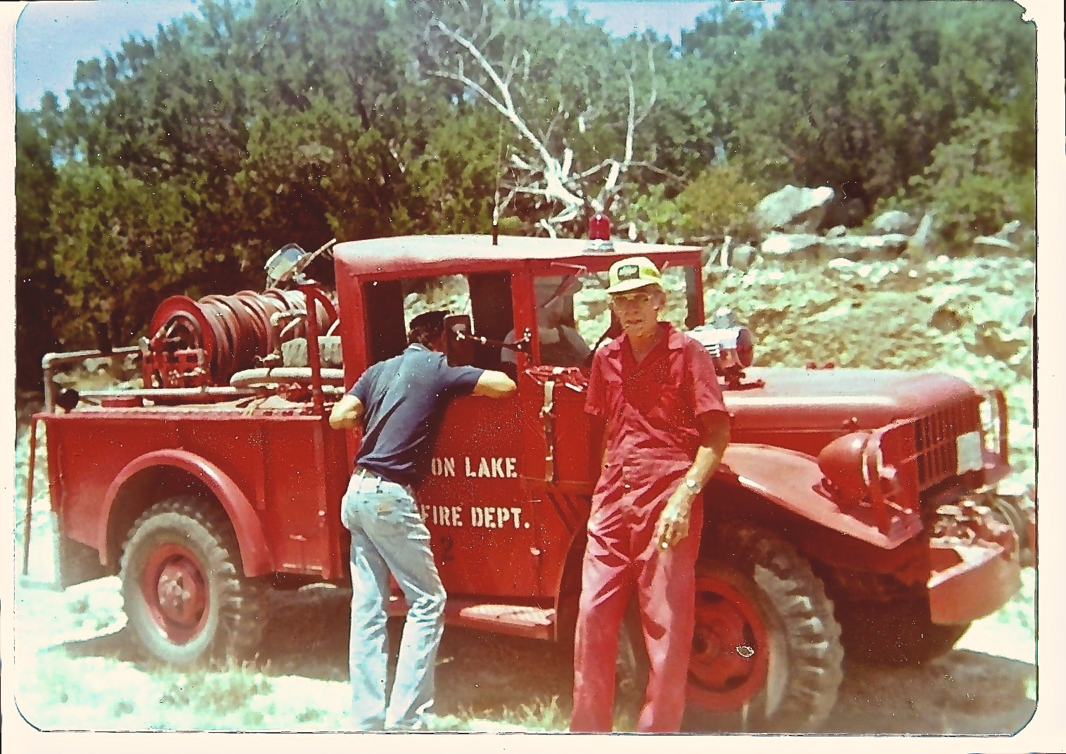 Old photo of Village Fireman and his Fire Truck