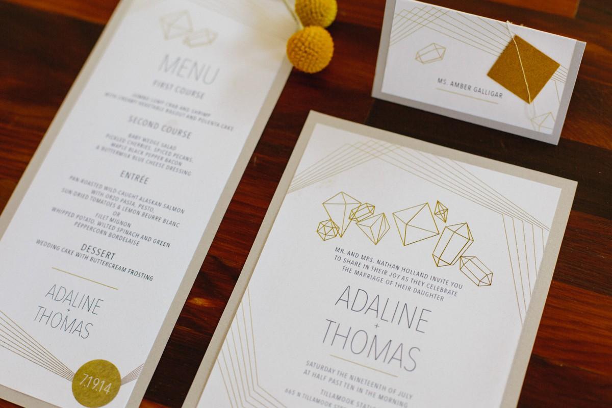Geometric gold wedding invitation suite