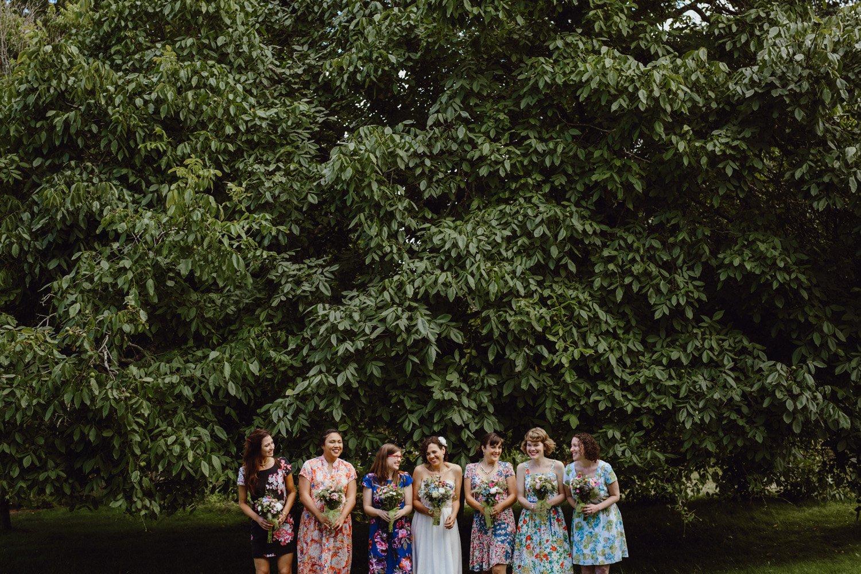 Bridesmaids in mismatched floral dresses.