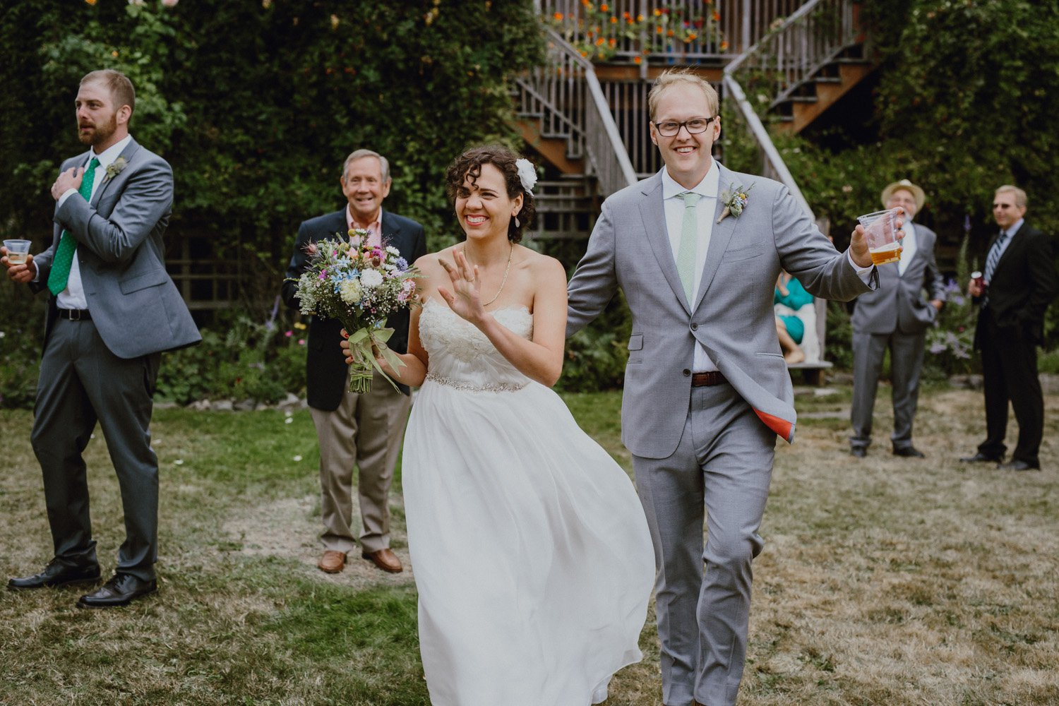 The bride and groom being welcomed into the reception captured by Catalina Jean Photography