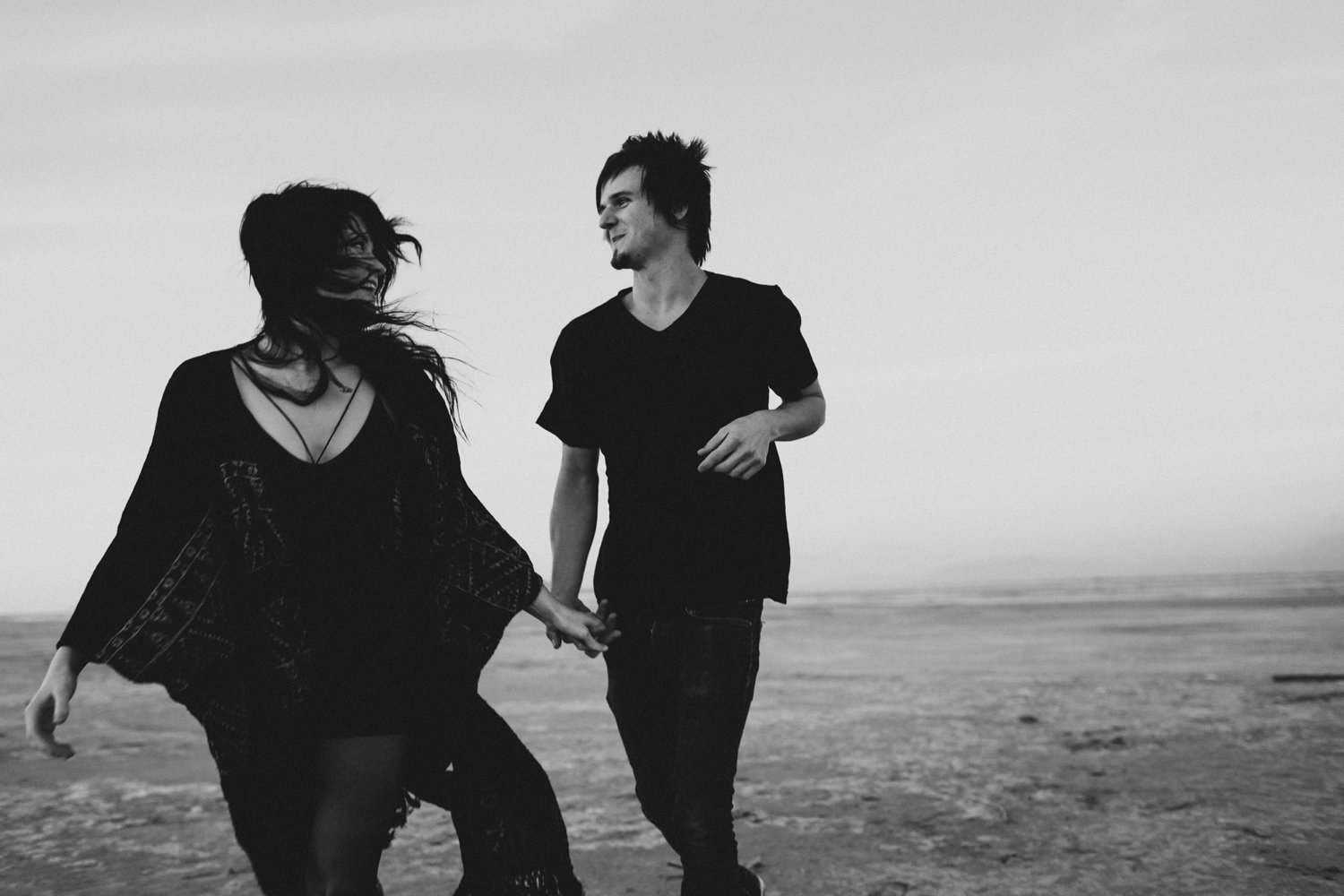 Black and white of a couple running
