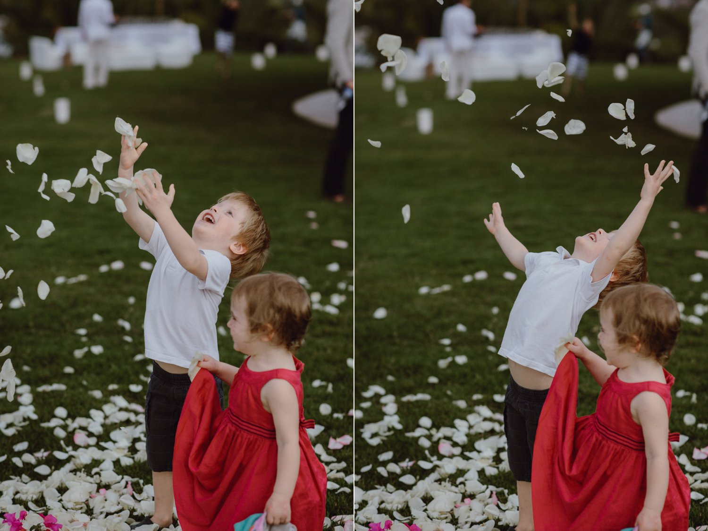 Candid wedding photo of children playing