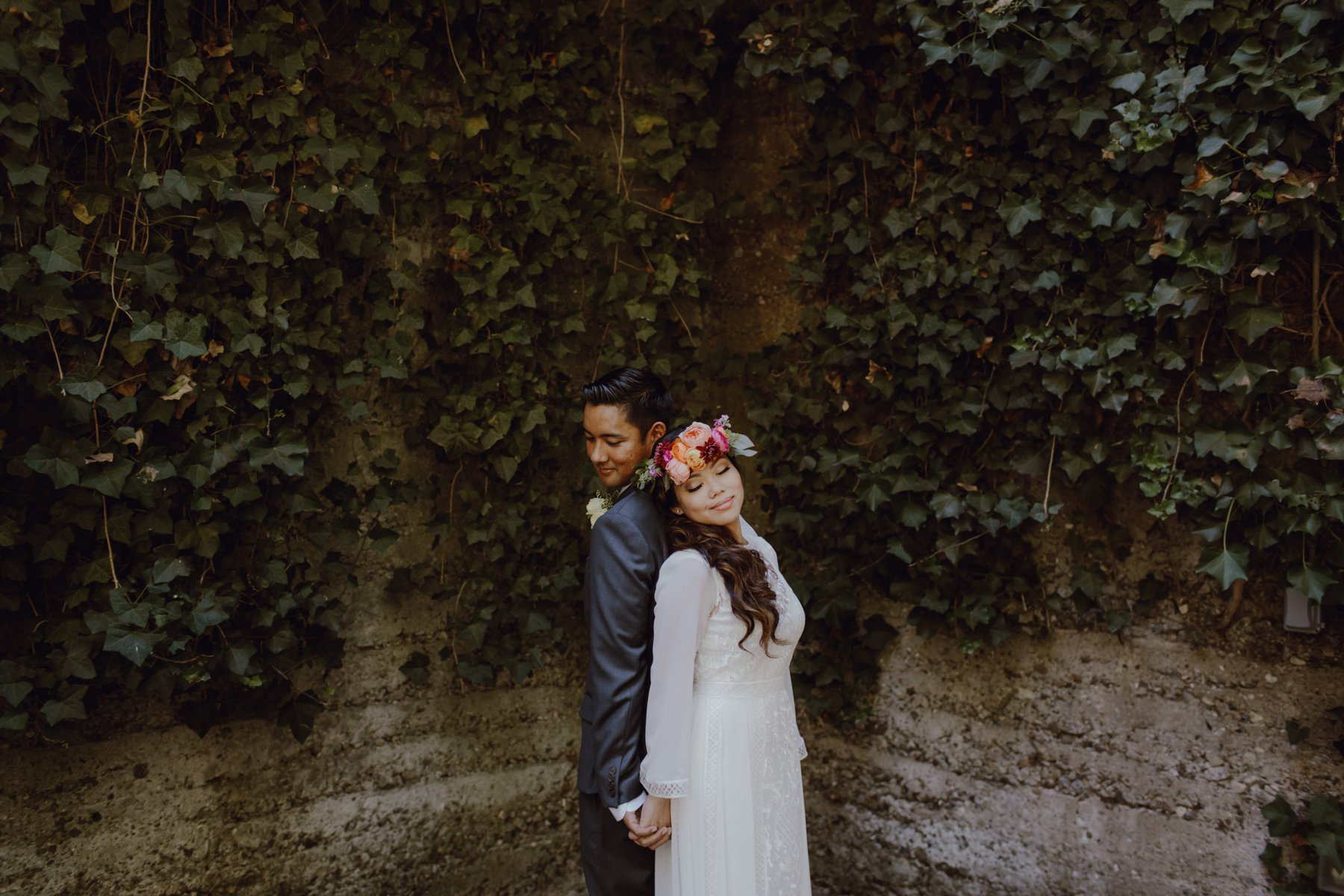 Bride and groom at their Sand Rock Farm wedding with a BHLDN gown and boho details