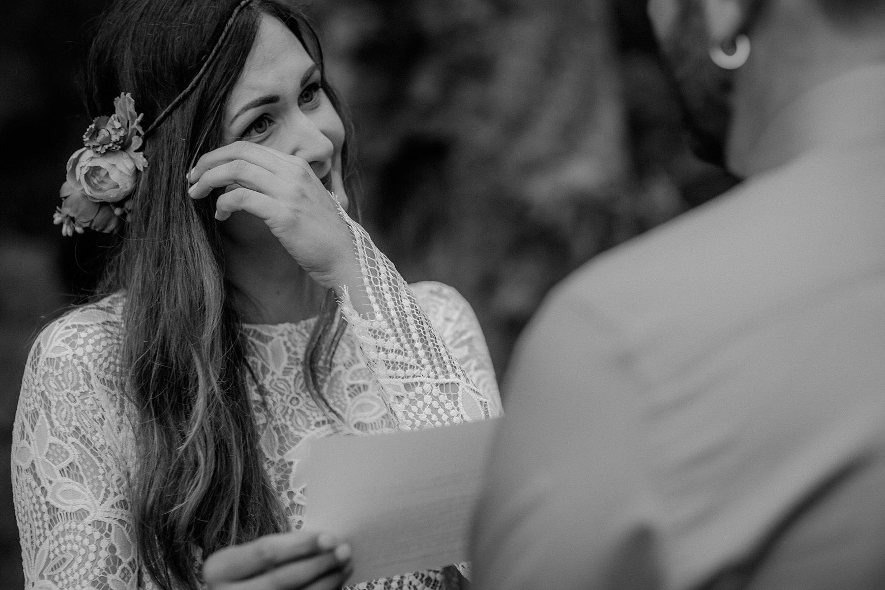 A bride cries at her elopement wedding.
