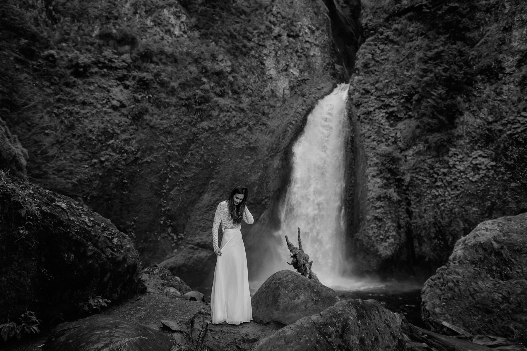 A bride in front of Wahclella Falls in the Columbia Gorge by Catalina Jean