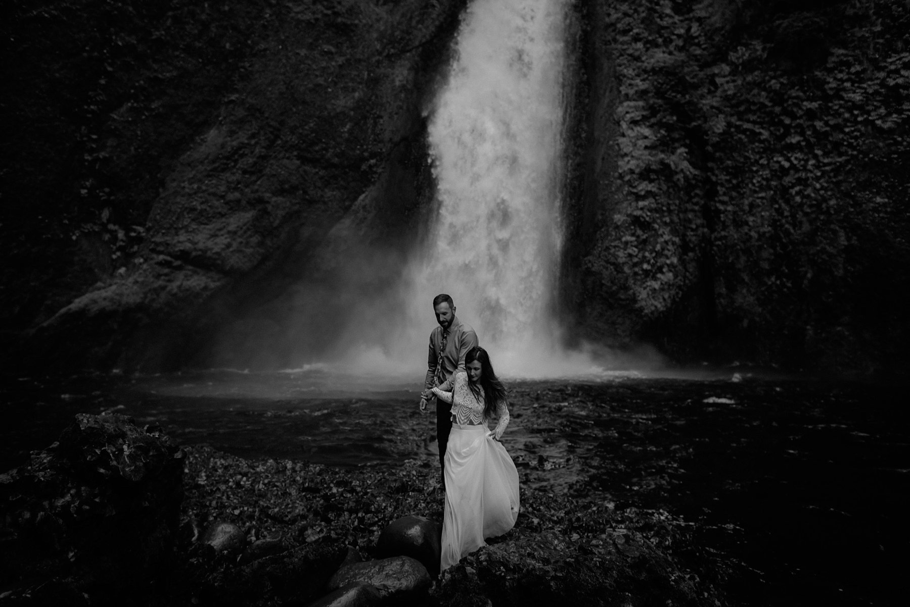 A bride and groom below Wahclella Falls at their elopement wedding by Portland photographer Catalina Jean