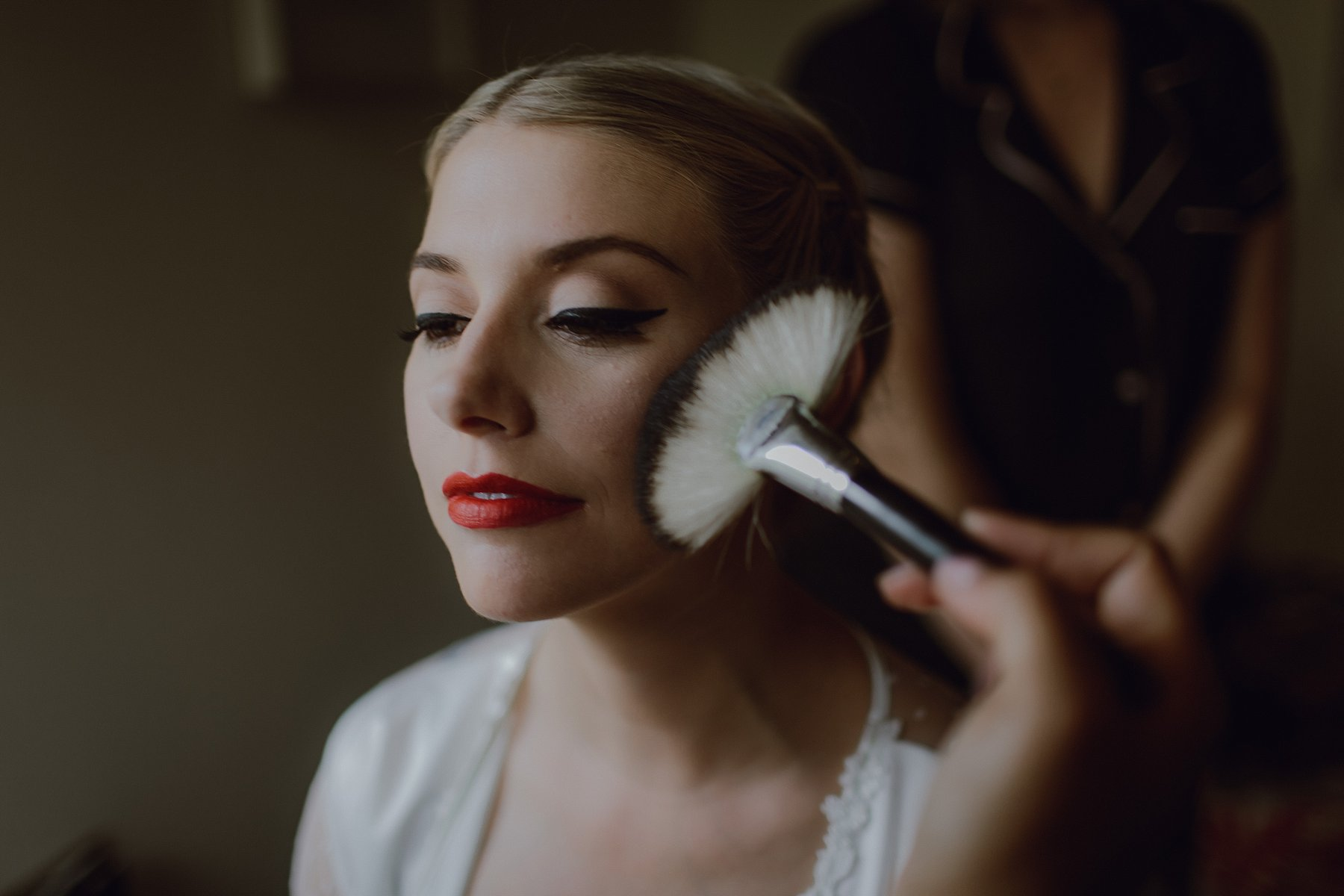 A bride gets ready at her Sweet Olive Farm wedding by Catalina Jean Photography