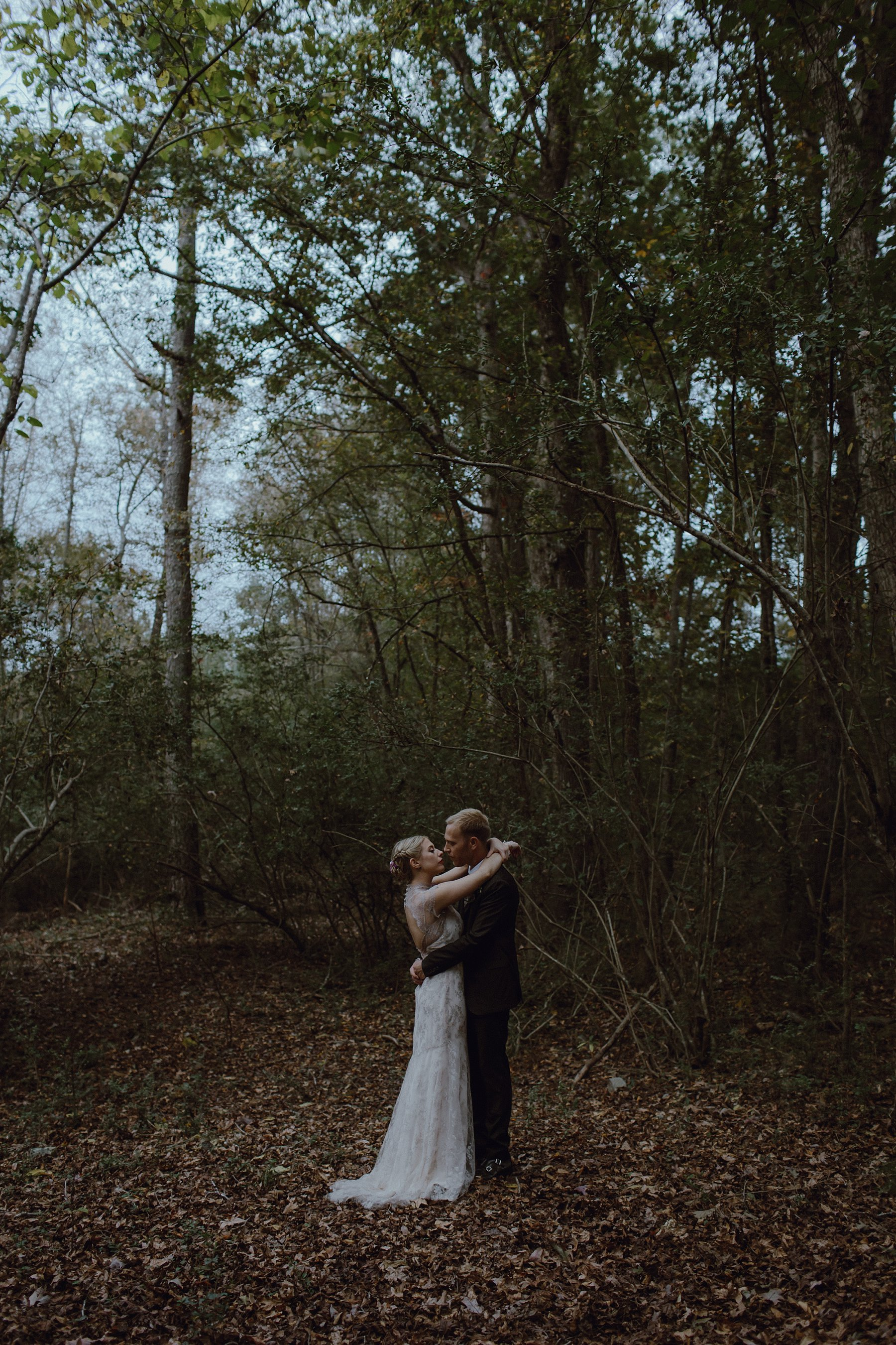 A forest photo of a bride and groom by Catalina Jean Photography