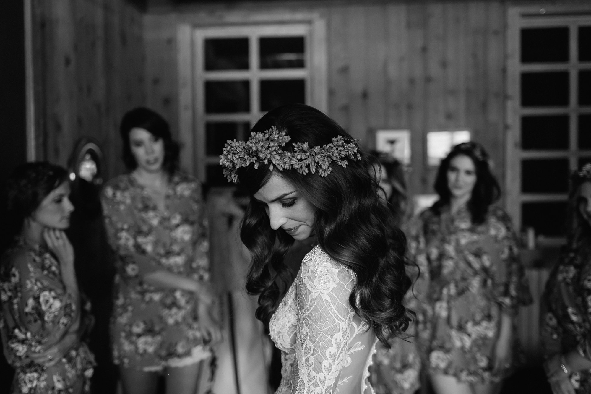 A bride puts on her dress at Ten Mile Station by Catalina Jean Photography