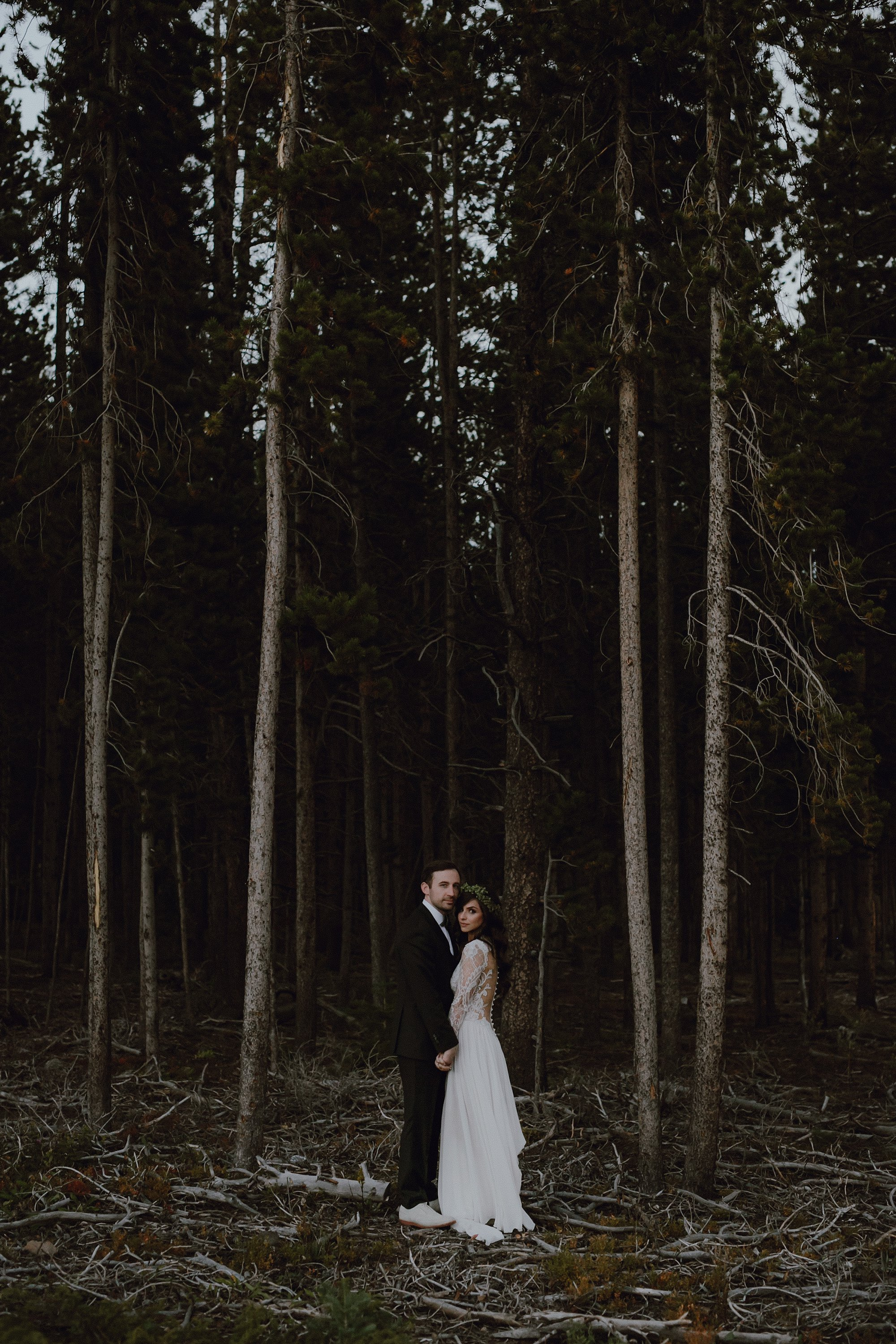 A bride and groom photo in the forest at Ten Mile Station