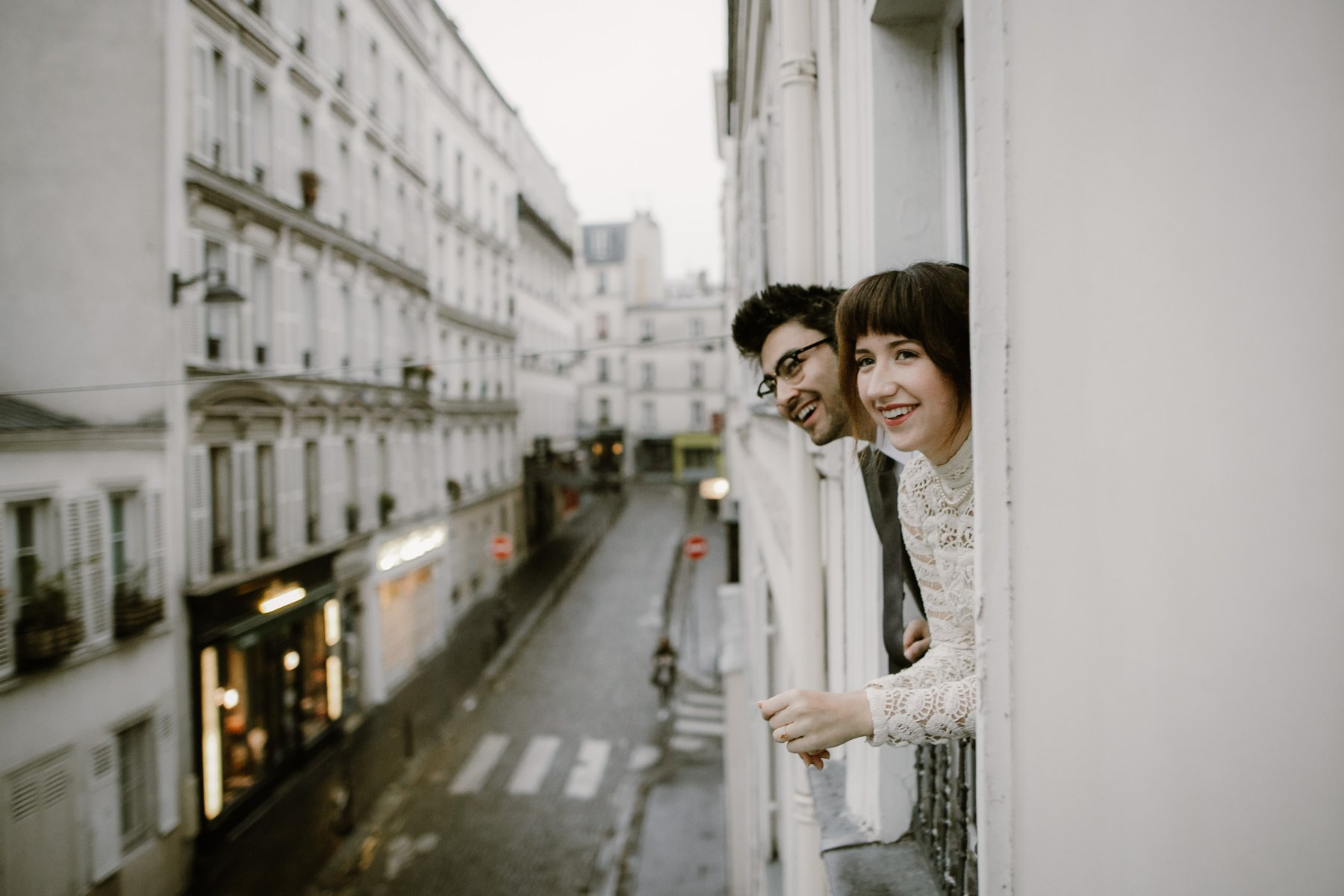 A bride and groom in the streets of Paris before their Parc Monceau wedding