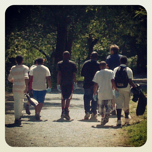 Fearless leader Bob Langston guides a group of youth off on a litter clean-up on the nature trails in the park.