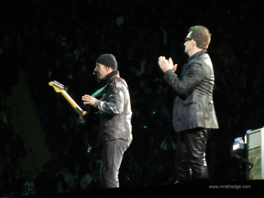 Yep, that's The Edge rocking out in a scarf