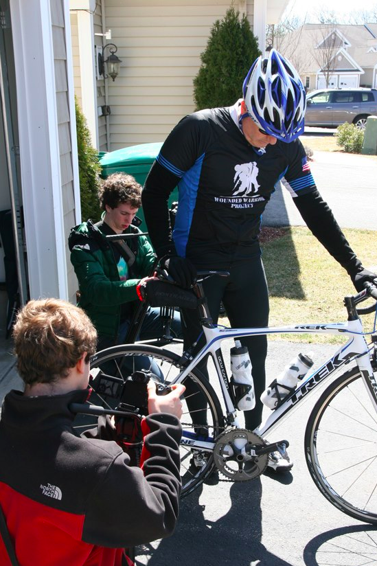 Phillip Schoening mounts his bicycle before heading off for a bike ride.