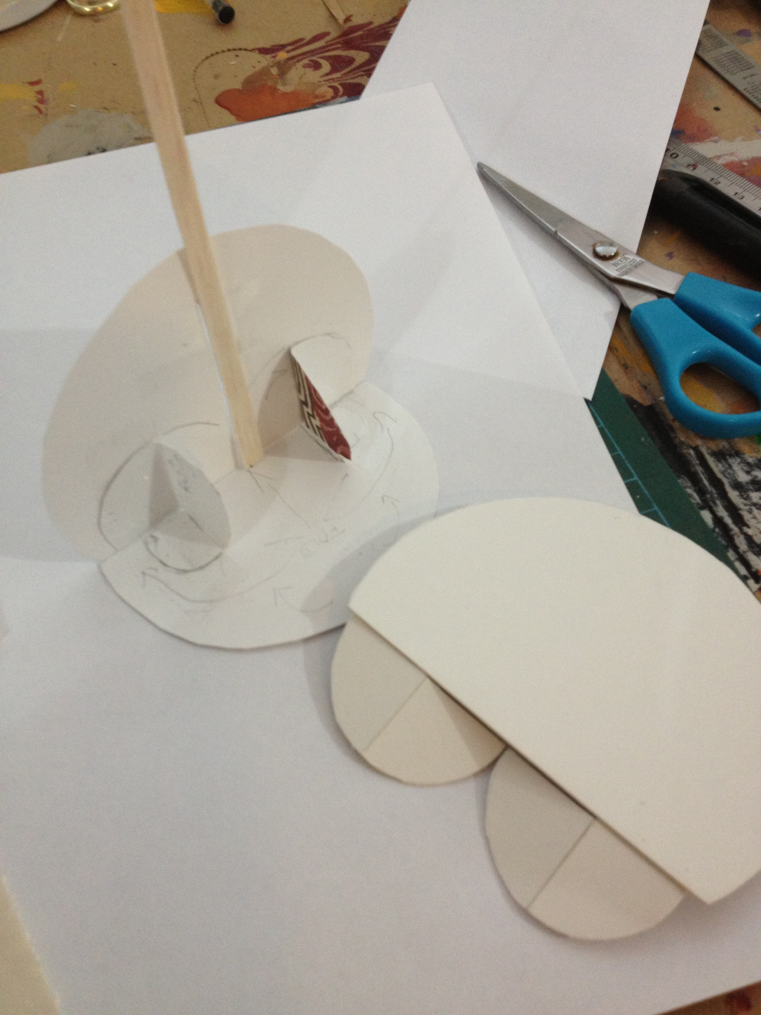 Going with a semi circle motif, the stand folds flat for storage inside the folder.