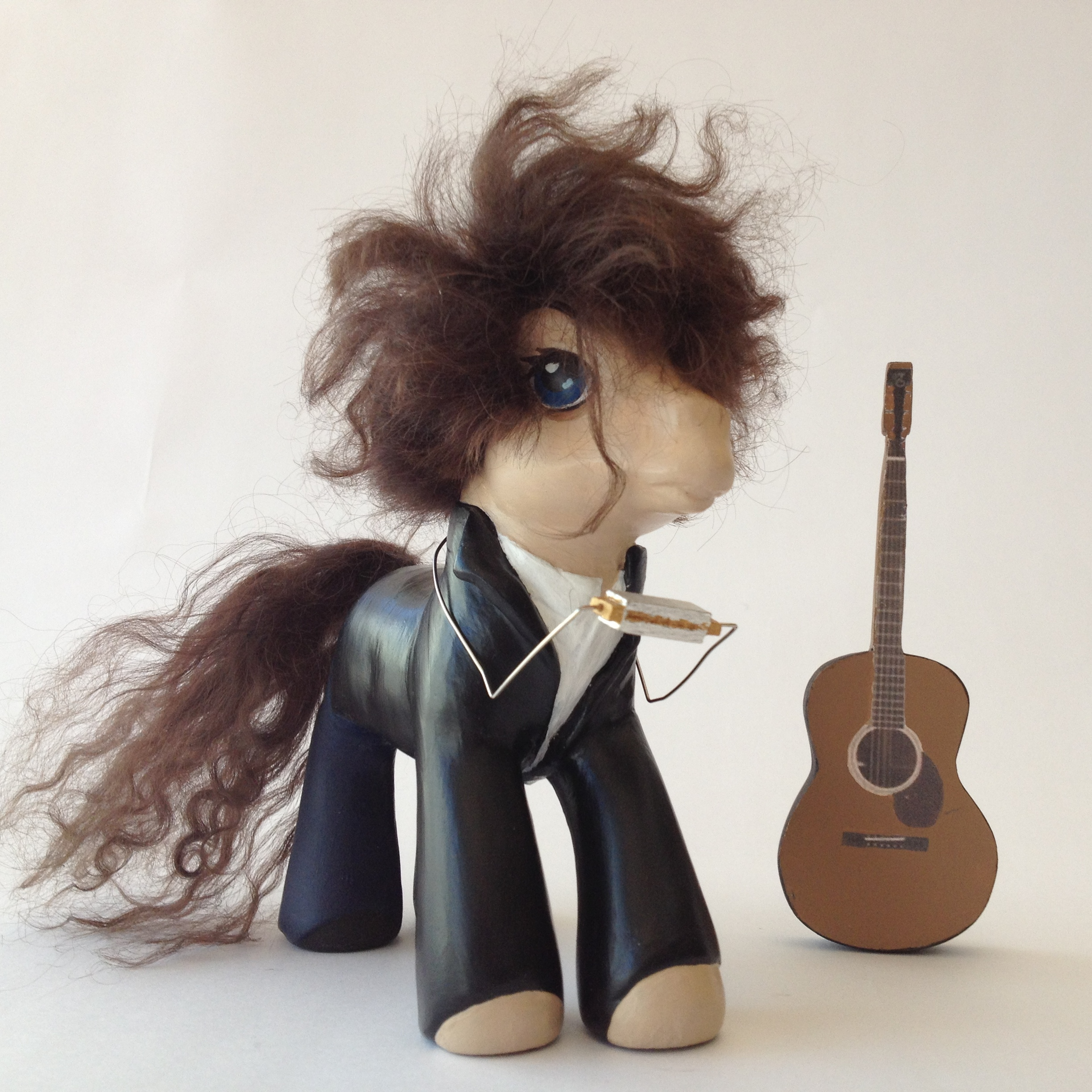 Da MAN. Complete with guitar & harmonica. And hair.