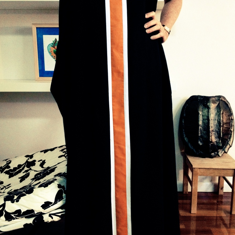 Maxi length, uses a whole lot of fabric but feels goddess like.