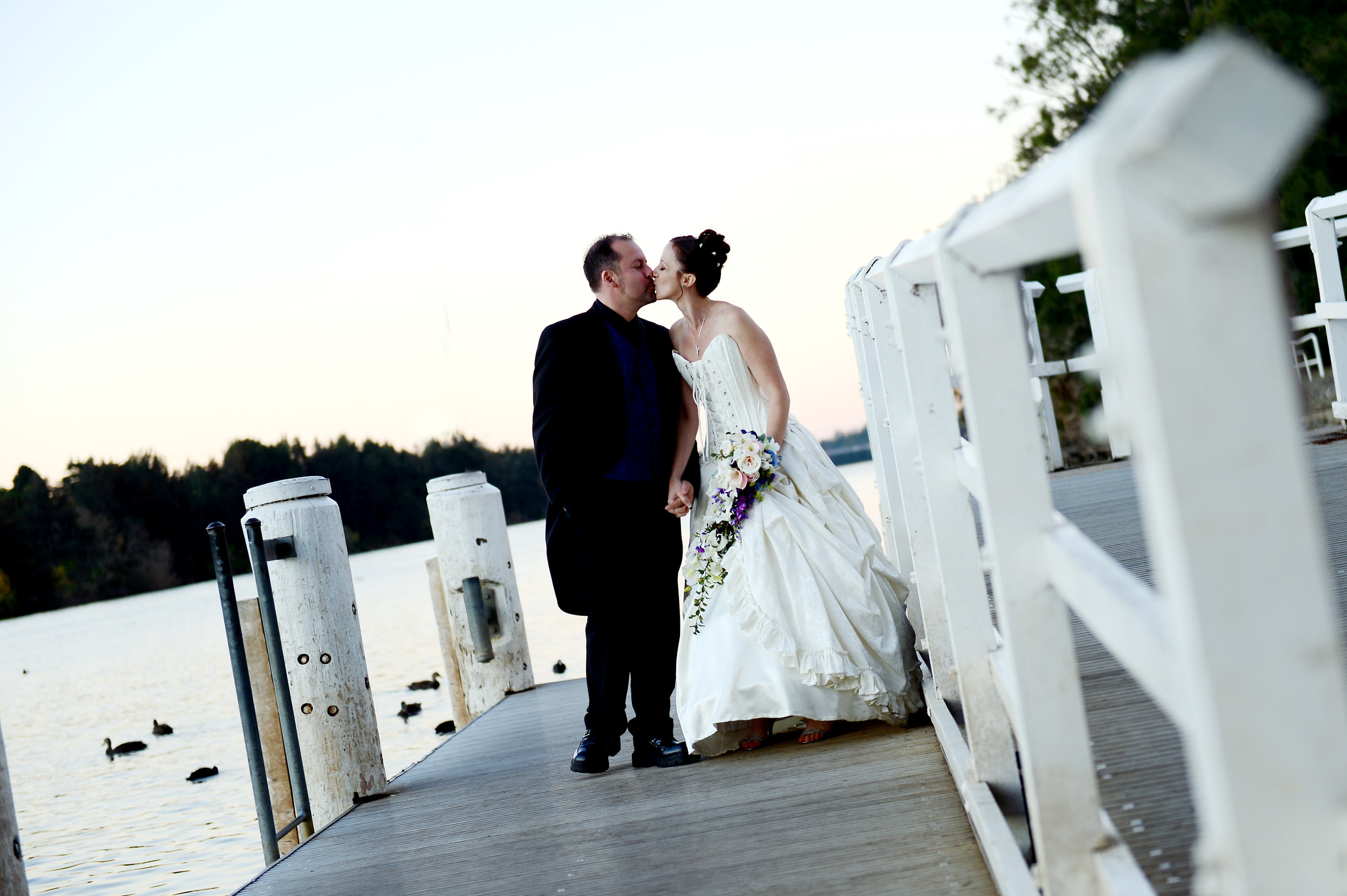 Belle wedding bride groom kiss wharf jetty river.JPG