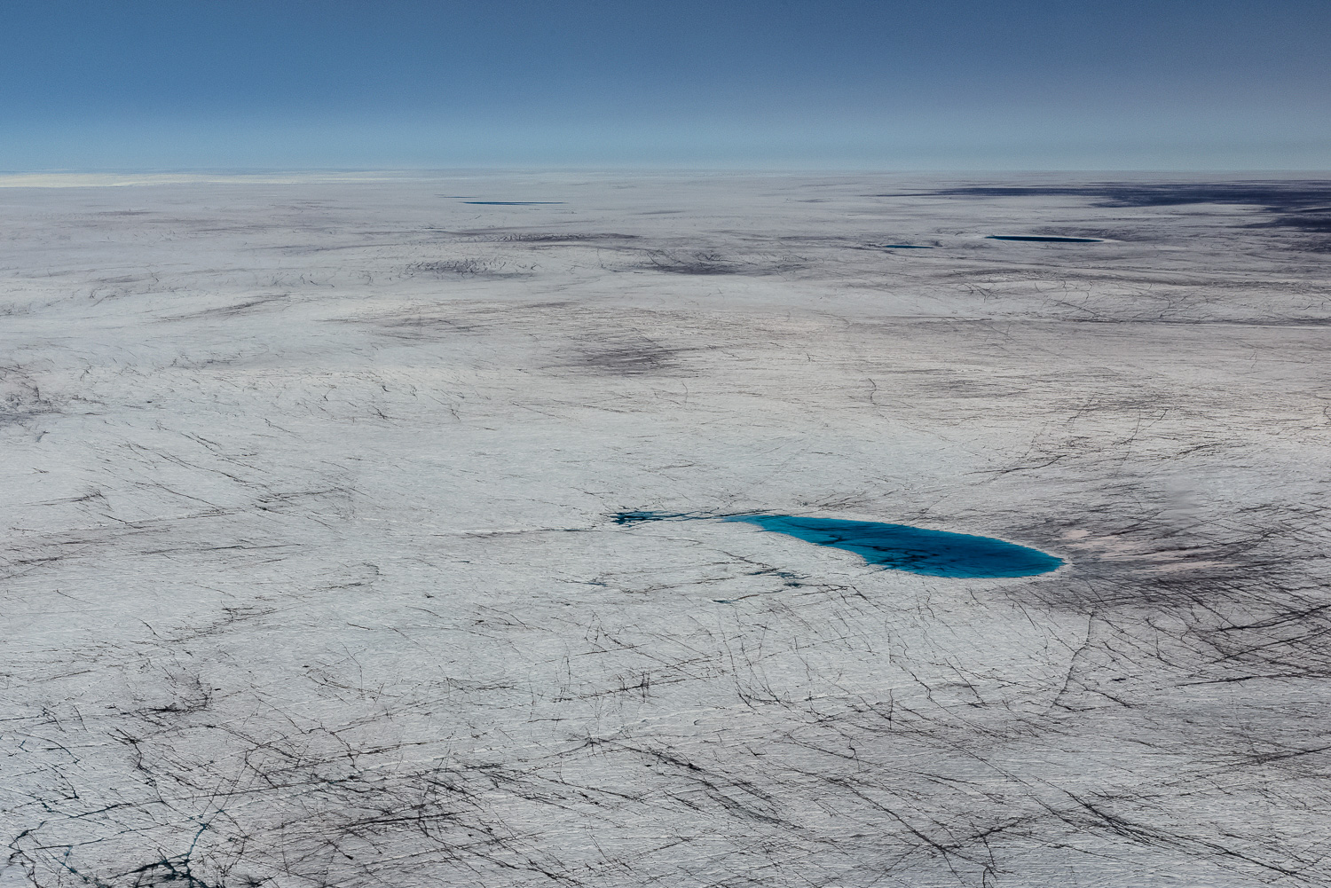 Meltwater Lake and Dark Ice