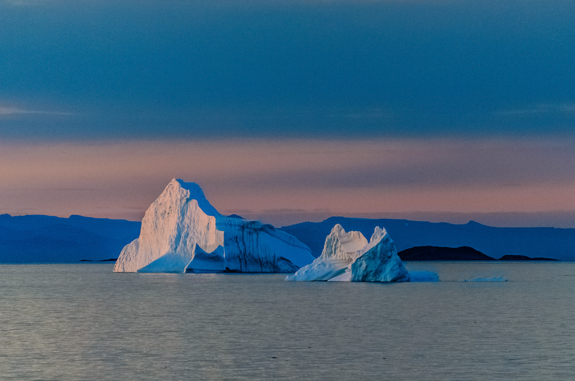 Colorful Icebergs at Evening