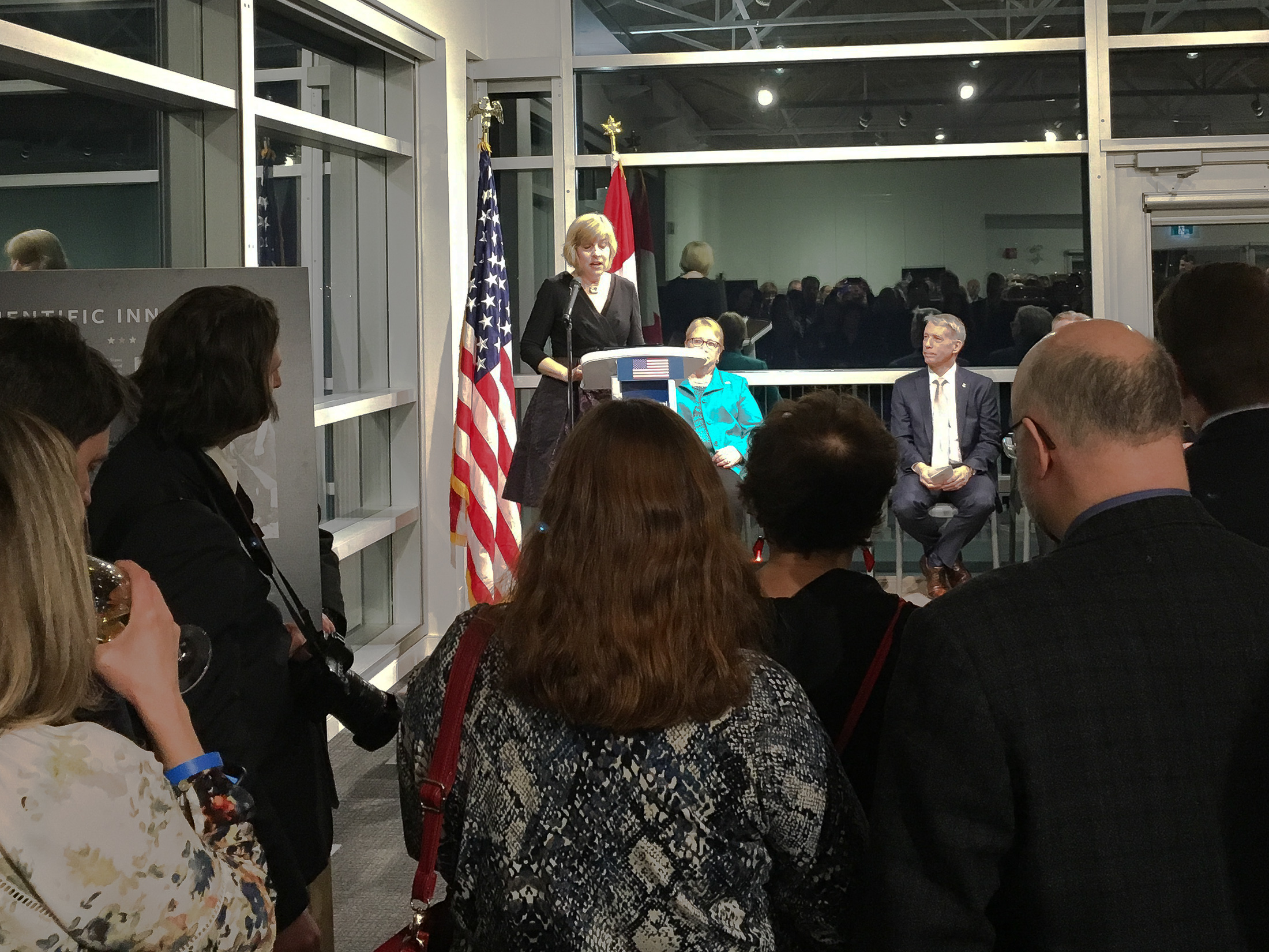 United States acting ambassador Elizabeth Moore Aubin offers remarks at the opening of the exhibition.