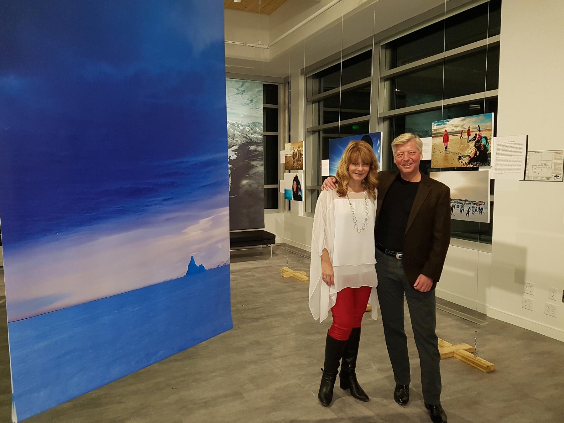 Canadian Arctic photographer Michelle Valberg and American Arctic photographer Stephen Gorman in front of some of Michelle's and Stephen's photographs.