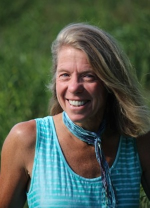 """Peg   Margaret Crawford is an RN, certified Yoga Instructor, Ayurveda diet and lifestyle consultant, and Level III Reiki practitioner.  After many years of practicing Yoga her hamstrings remain tight and she can't balance on her right leg, but she now realizes this does not make or break a yogi. """"The goal of Yoga is to make a happy home."""" Swami Vimalananda said, and Peg has slowly, so slowly, begun to see this is true and that which we gain in Yoga goes far beyond asana and looking good in tights. Yoga is a sweet path for Peg because it helps her go in, get quiet, really experience her body and thoughts. For this reason Peg loves to share restorative Yoga and Yoga Nidra with people. She knows we can heal only when we are at rest and our mind, body, and soul are peaceful. This is her wish for you."""